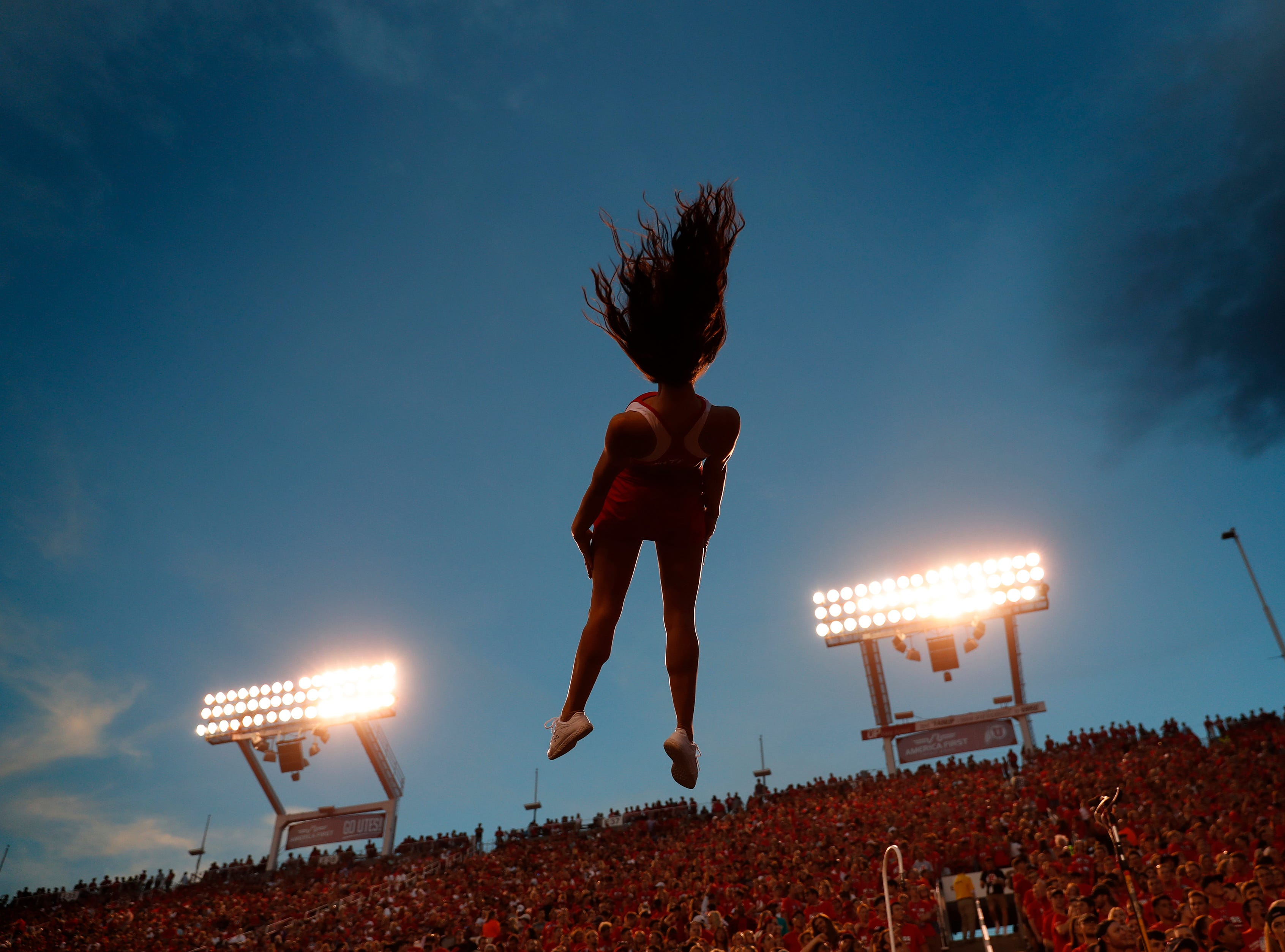 Week 1: Utah Utes cheerleaders perform in the third quarter against the Weber State Wildcats at Rice-Eccles Stadium.