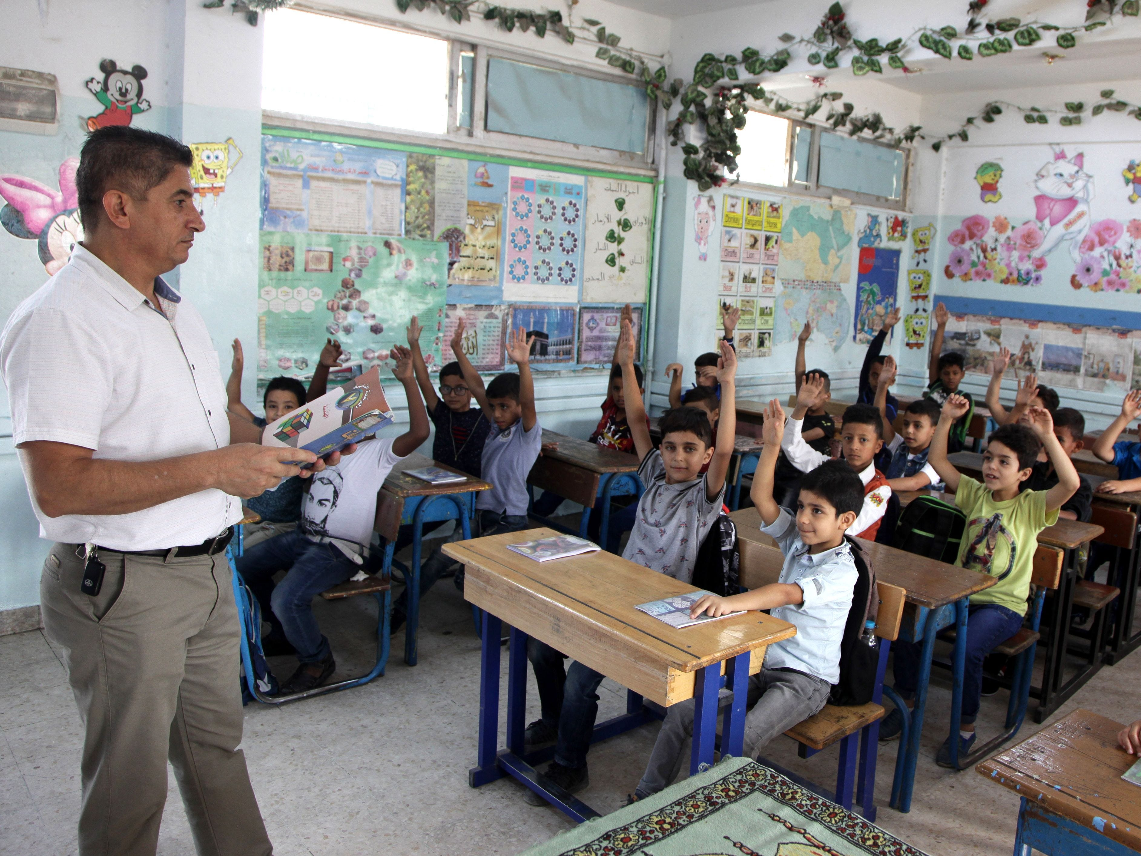 "Palestinian refugee pupils attend a lesson at a United nations Relief and Works Agency's (UNRWA, UN agency for Palestinian refugees) school, in the Al-Baqaa Palestinian refugee camp, near Amman, on 2 september 2018. - The UN agency for Palestinian refugees (UNRWA) has been a lifeline for millions of Palestinians since it was set up nearly 70 years ago. On August 31, the United States, by far the biggest contributor to the agency, announced it was halting its funding to the organisation, which it labelled ""irredeemably flawed"". (Photo by AHMAD ABDO / AFP)AHMAD ABDO/AFP/Getty Images ORIG FILE ID: AFP_18S64S"