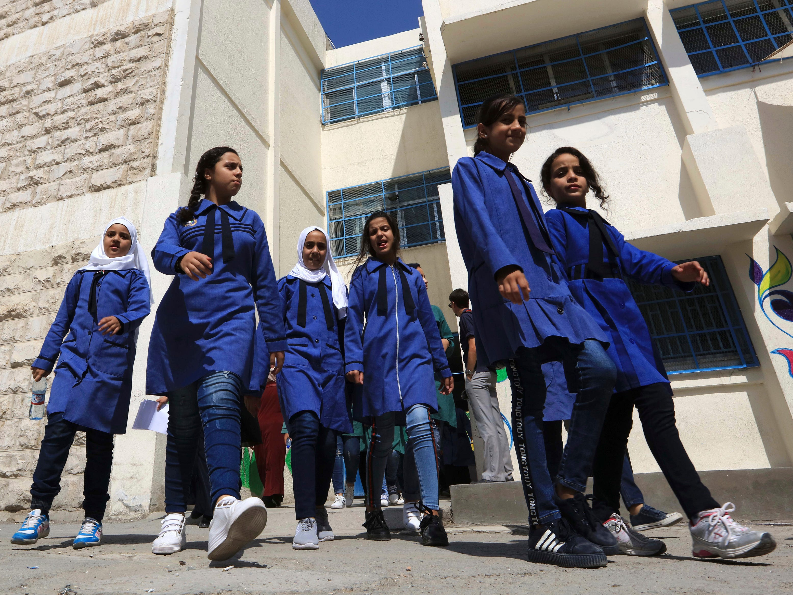 Refugee schoolchildren attend a ceremony to mark the return to school at one of the UNRWA schools at a Palestinian refugee camp Al-Wehdat, in Amman, Jordan, Sunday, Sept. 2, 2018. (AP Photo/Raad Adayleh) ORG XMIT: AMM10