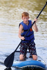 Benjamin Kimmel paddles his way across Robinwood Lake during the P3 Labor Day Challenge on Sept. 1, 2018 in Gastonia, N.C.