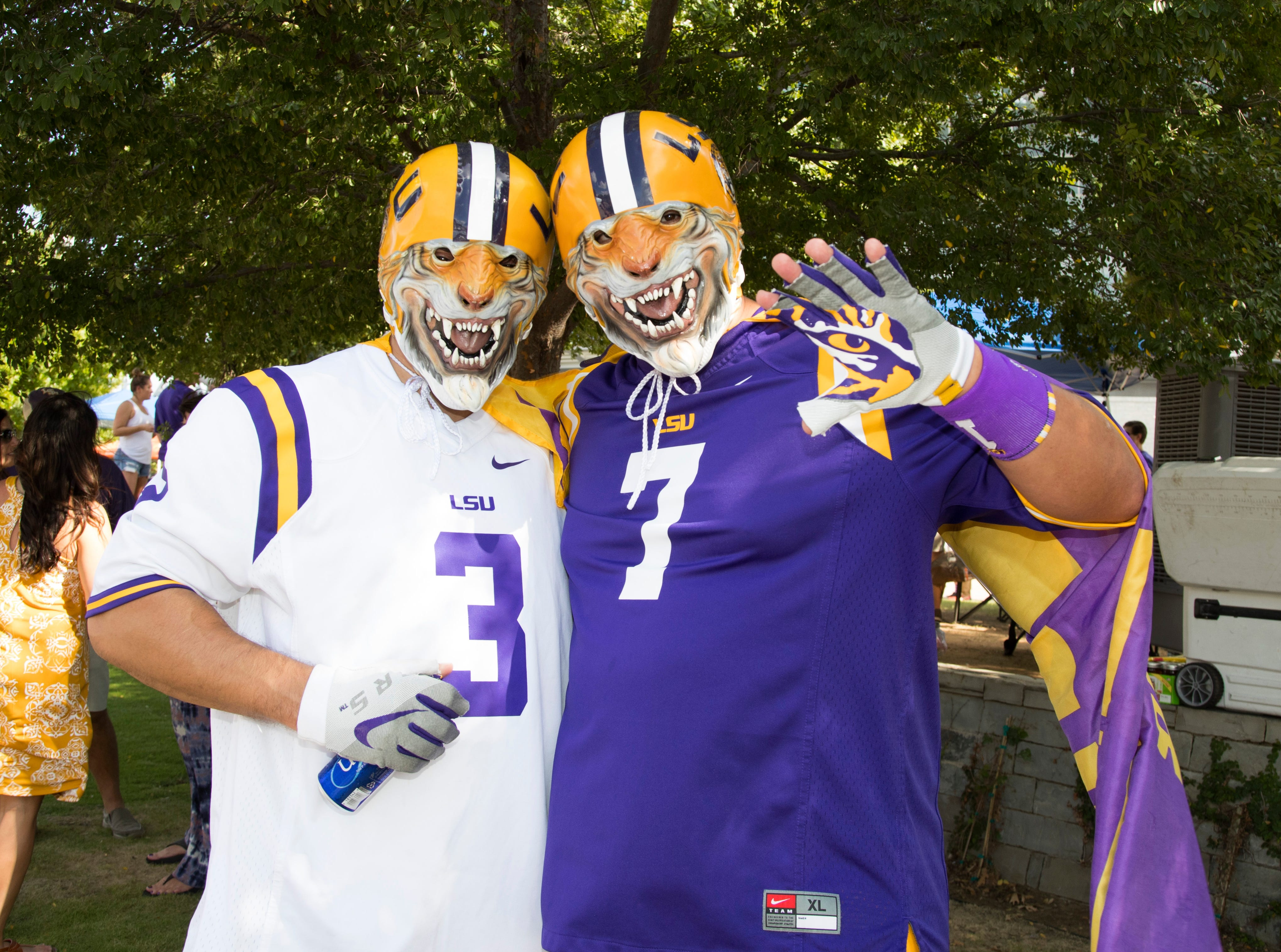 Week 1: LSU Tigers fans Chris Langley (left) and Jonathan Cernek pose for a photo before the game against the Miami Hurricanes at AT&T Stadium.