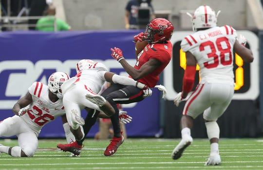 Texas Tech wide receiver T.J. Vasher is tackled by Mississippi defensive back Jaylon Jones.