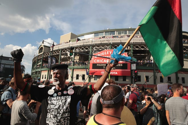 Demonstrators protest in front of Wrigley Field before  the start of the game  between the Cubs and the Padres on August 2, 2018 in Chicago.