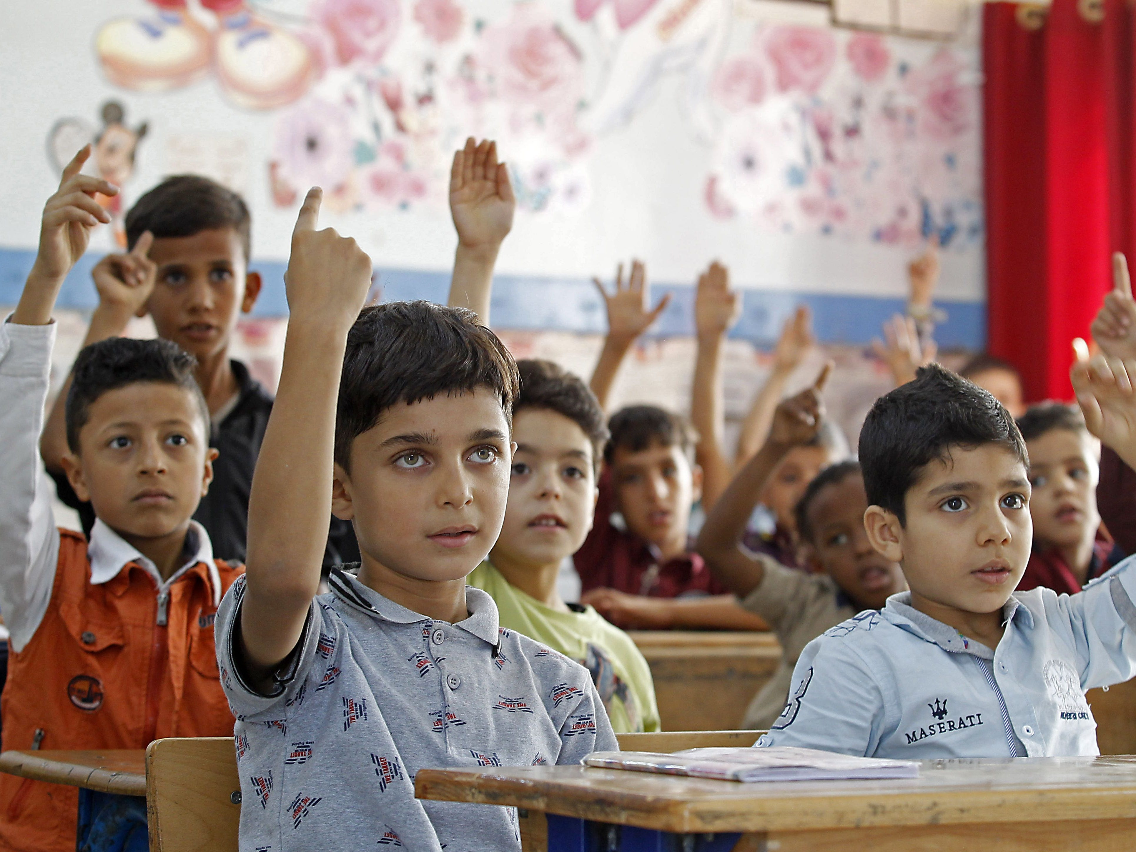 "Palestinian refugee pupils attend a lesson at a United nations Relief and Works Agency's (UNRWA, UN agency for Palestinian refugees) school, in the Al-Baqaa Palestinian refugee camp, near Amman, on 2 september 2018. - The UN agency for Palestinian refugees (UNRWA) has been a lifeline for millions of Palestinians since it was set up nearly 70 years ago. On August 31, the United States, by far the biggest contributor to the agency, announced it was halting its funding to the organisation, which it labelled ""irredeemably flawed"". (Photo by AHMAD ABDO / AFP)AHMAD ABDO/AFP/Getty Images ORIG FILE ID: AFP_18S64M"