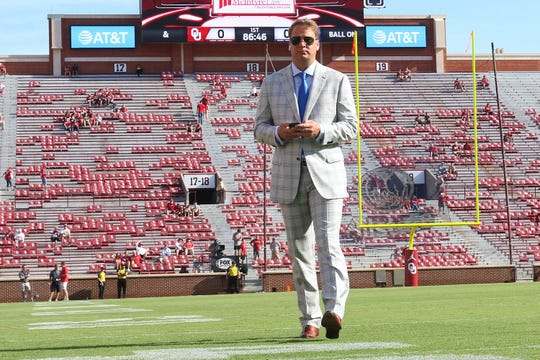 Florida Atlantic coach Lane Kiffin walks in the field at Gaylord Memorial Stadium before his game against Oklahoma.