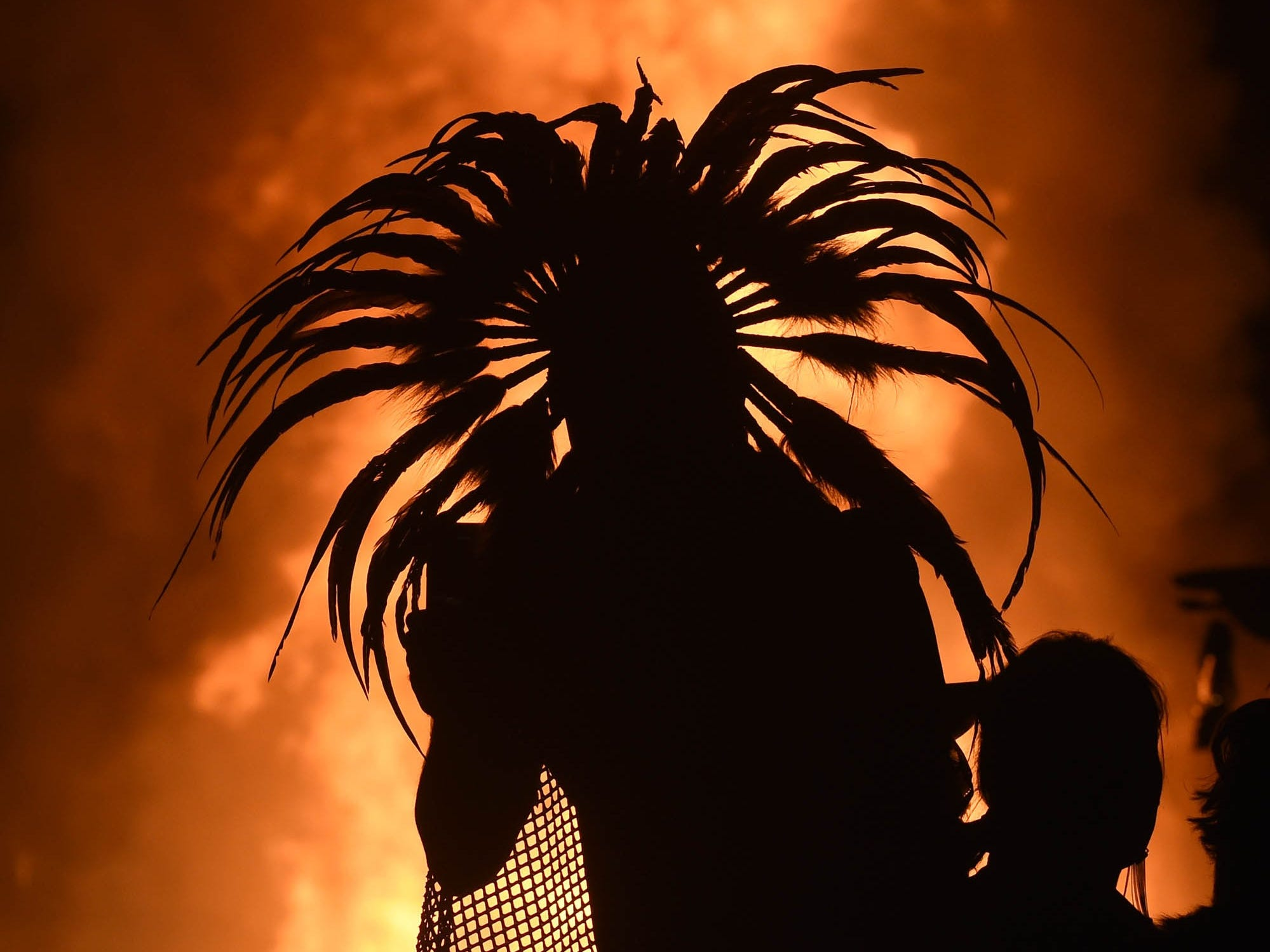 Tens of thousands of people gathered at the Burning Man festival to watch the the nearly 100-foot towering effigy of the Man burst into flames and collapse to the ground. After 30 minutes of fire performers, a spectacular fireworks display set the Man ablaze -- one of the most-anticipated events at the week-long pop-up city in the Nevada desert.