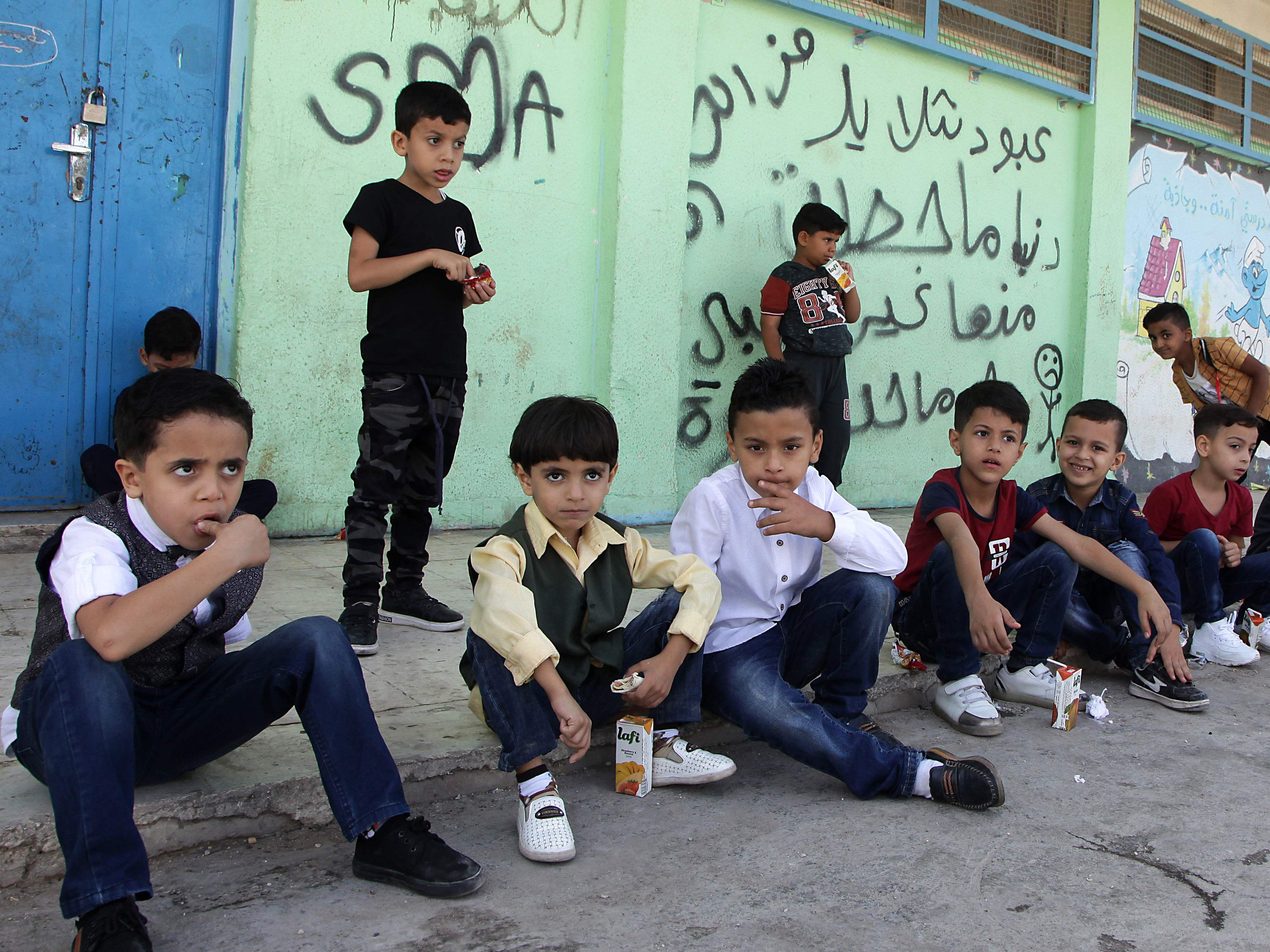 "Palestinian refugee pupils wait outside a United nations Relief and Works Agency's (UNRWA, UN agency for Palestinian refugees) school, in the Al-Baqaa Palestinian refugee camp, near Amman, on 2 september 2018. - The UN agency for Palestinian refugees (UNRWA) has been a lifeline for millions of Palestinians since it was set up nearly 70 years ago. On August 31, the United States, by far the biggest contributor to the agency, announced it was halting its funding to the organisation, which it labelled ""irredeemably flawed"". (Photo by AHMAD ABDO / AFP)AHMAD ABDO/AFP/Getty Images ORIG FILE ID: AFP_18S64U"