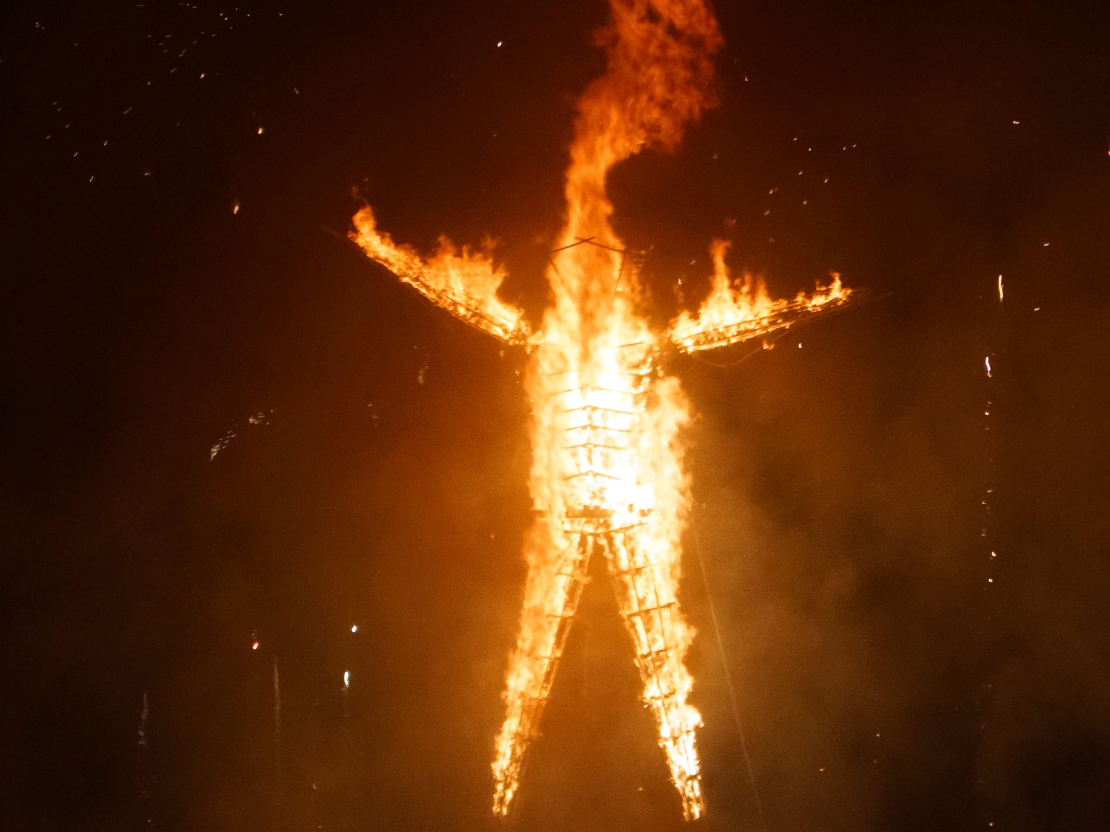 The approximately 100-foot-tall Man burns on Saturday night during a raucous celebration at Burning Man.