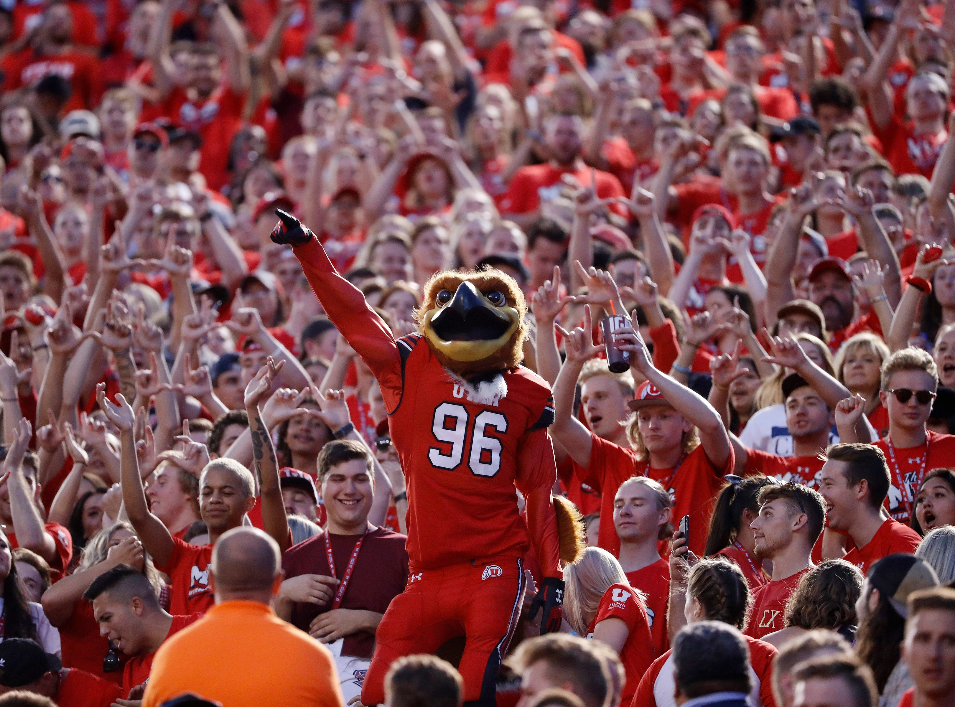 Week 1: The Utah Utes mascot Swoop shows his spirit along with fans against the Weber State Wildcats at Rice-Eccles Stadium.