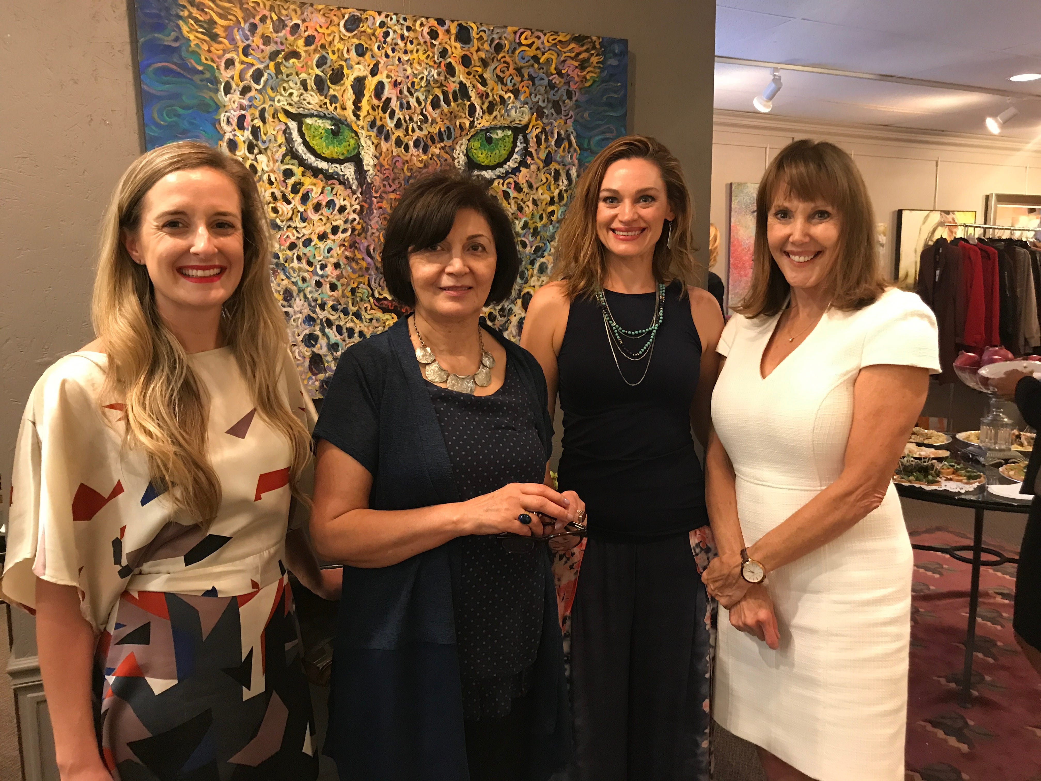 Mehri Hosseini, second from left, curator and owner of Hermitage Gallery in McLean, poses with USA TODAY's Cara Kelly, left, Sytera Field and Jayne O'Donnell (on right). Field now hopes to feature some of Hermitage's art in an expanded studio the yoga instructor hopes to open soon.