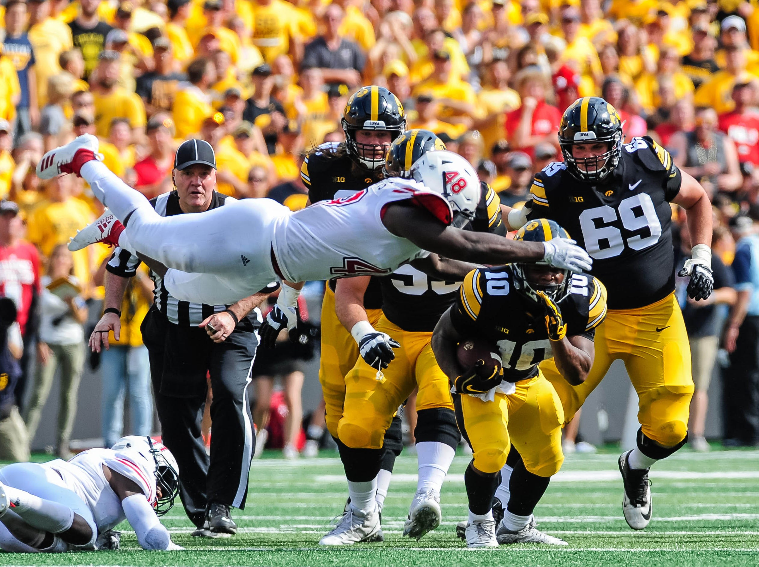 Northern Illinois Huskies linebacker Antonio Jones-Davis (48) leaps to tackle Iowa Hawkeyes running back Mekhi Sargent (10) during the second quarter at Kinnick Stadium.
