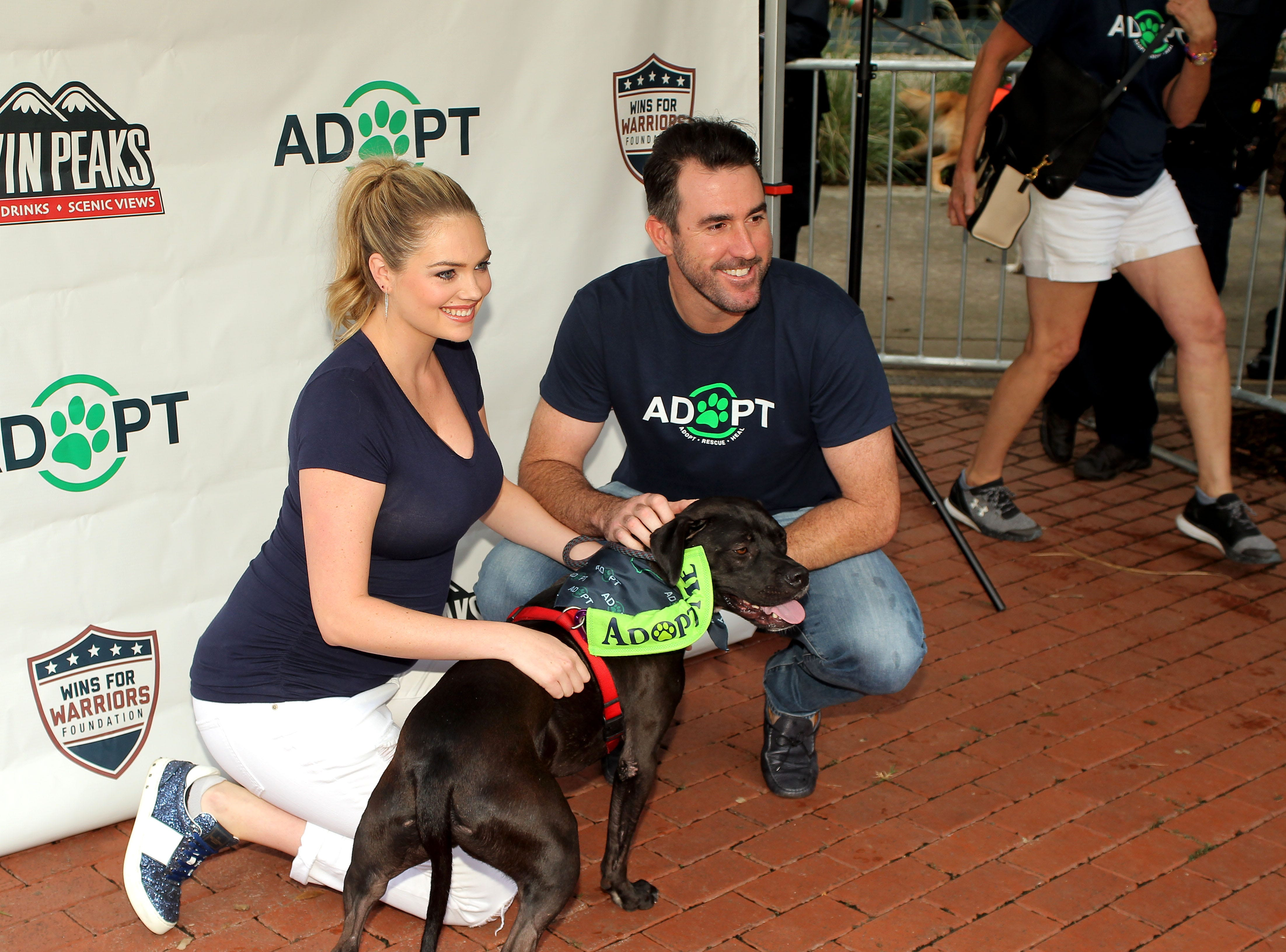 Houston Astros starting pitcher Justin Verlander and wife Kate Upton pose for photos during the Astros' Dog Day event.
