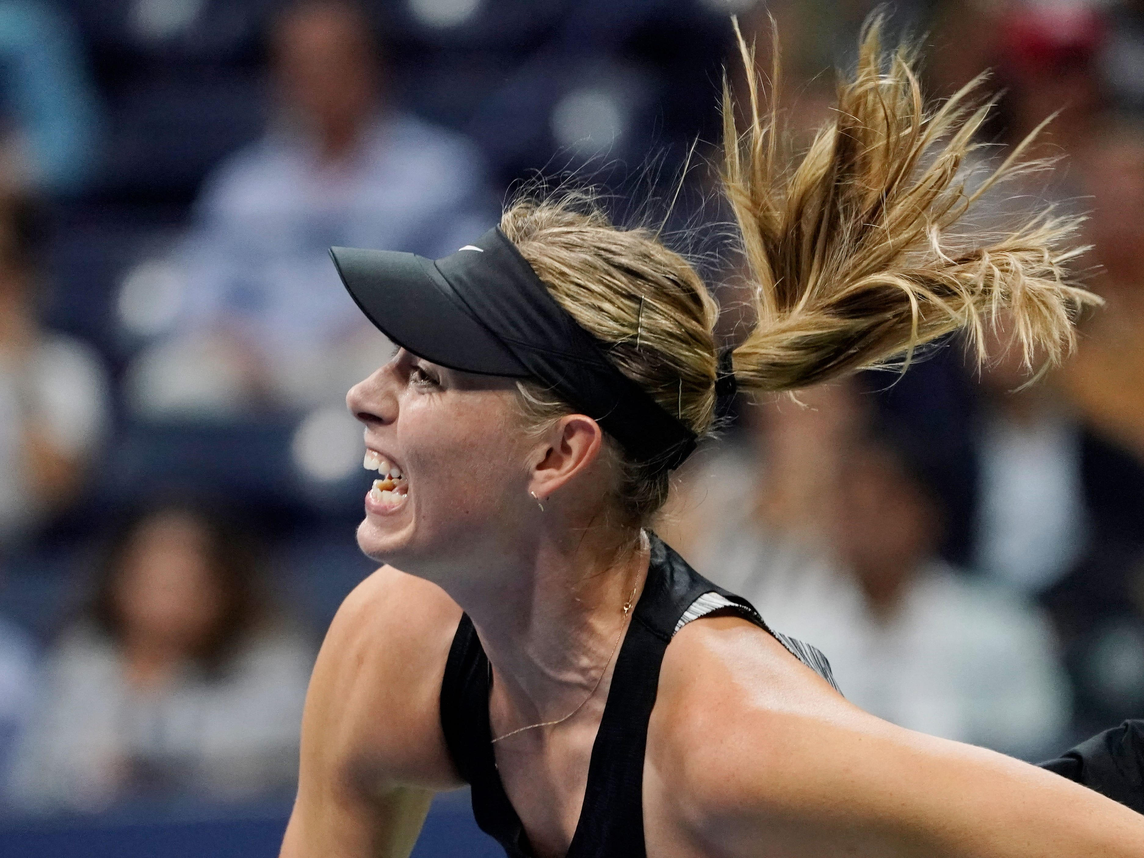 Maria Sharapova of Russia hits to Jelena Ostapenko of Latvia. Sharapova won in straight sets.