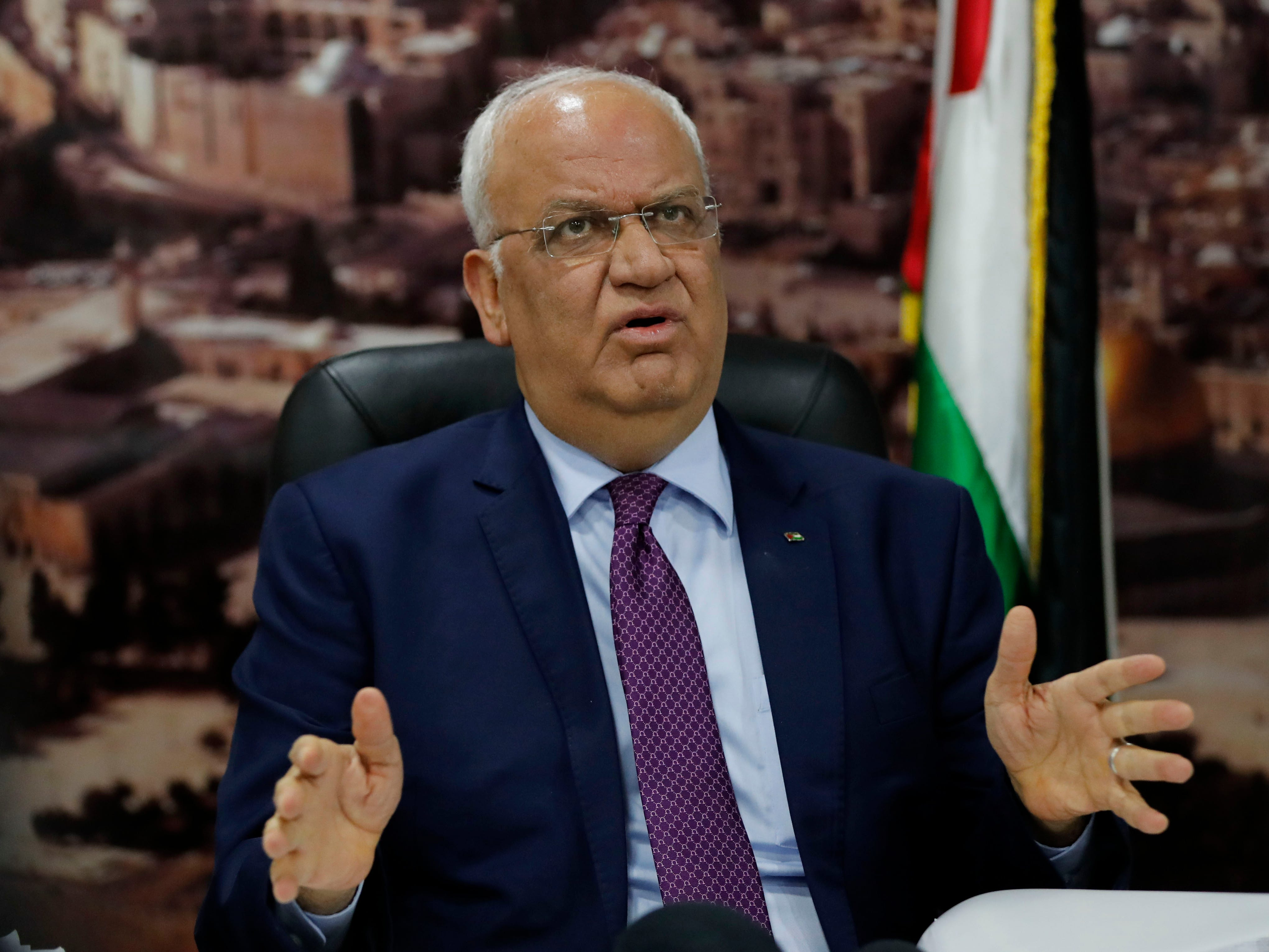 "Saeb Erekat, secretary general of the Palestine Liberation Organisation, speaks to journalists in the West Bank city of Ramallah on September 1, 2018 - Palestinians reacted angrily today to a US decision to end all funding for the UN agency that assists millions of refugees, seeing it as a new policy shift aimed at undermining their cause. Chief Palestinian negotiator Saeb Erekat said the American administration was invalidating future peace talks by ""preempting, prejudging issues reserved for permanent status"" negotiations. (Photo by AHMAD GHARABLI / AFP)AHMAD GHARABLI/AFP/Getty Images ORIG FILE ID: AFP_18R7TL"