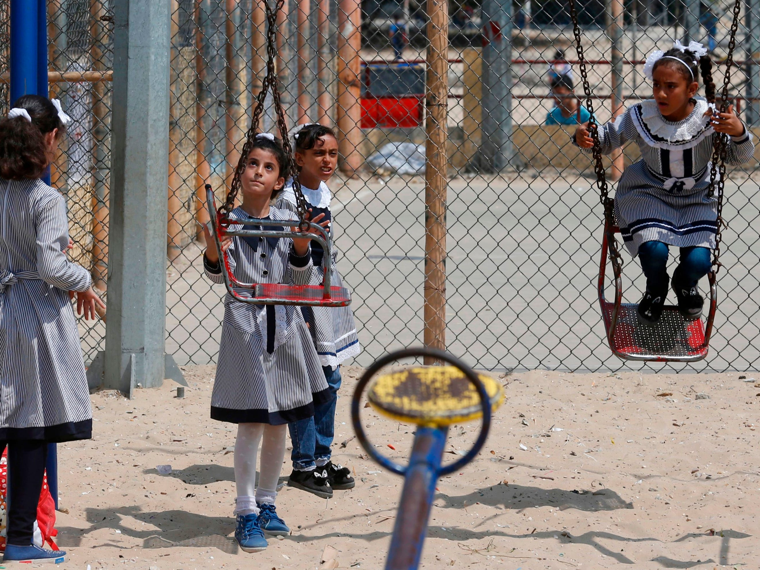 "Palestinian school girls play at UN Relief and Works Agency's (UNRWA) school in the Rafah refugee camp, southern Gaza Strip, on September 1, 2018. - The United States announced it was halting funding for the United Nations' agency for Palestinian refugees after declaring the organisation was ""irredeemably flawed. Washington has long been the UN Relief and Works Agency's (UNRWA) largest donor but is ""no longer willing to shoulder the very disproportionate share of the burden,"" State Department spokeswoman Heather Nauert said in a statement. (Photo by SAID KHATIB / AFP)SAID KHATIB/AFP/Getty Images ORG XMIT: 202 ORIG FILE ID: AFP_18R7S1"
