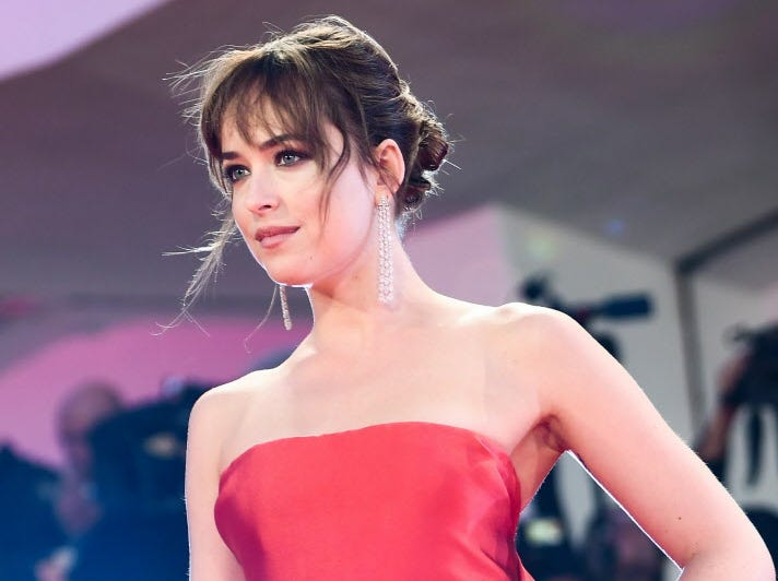 """Actress Dakota Johnson arrives for the premiere of the film """"Suspiria"""" presented in competition on September 1, 2018 during the 75th Venice Film Festival at Venice Lido. (Photo by Filippo MONTEFORTE / AFP)FILIPPO MONTEFORTE/AFP/Getty Images ORIG FILE ID: AFP_18S2VY"""