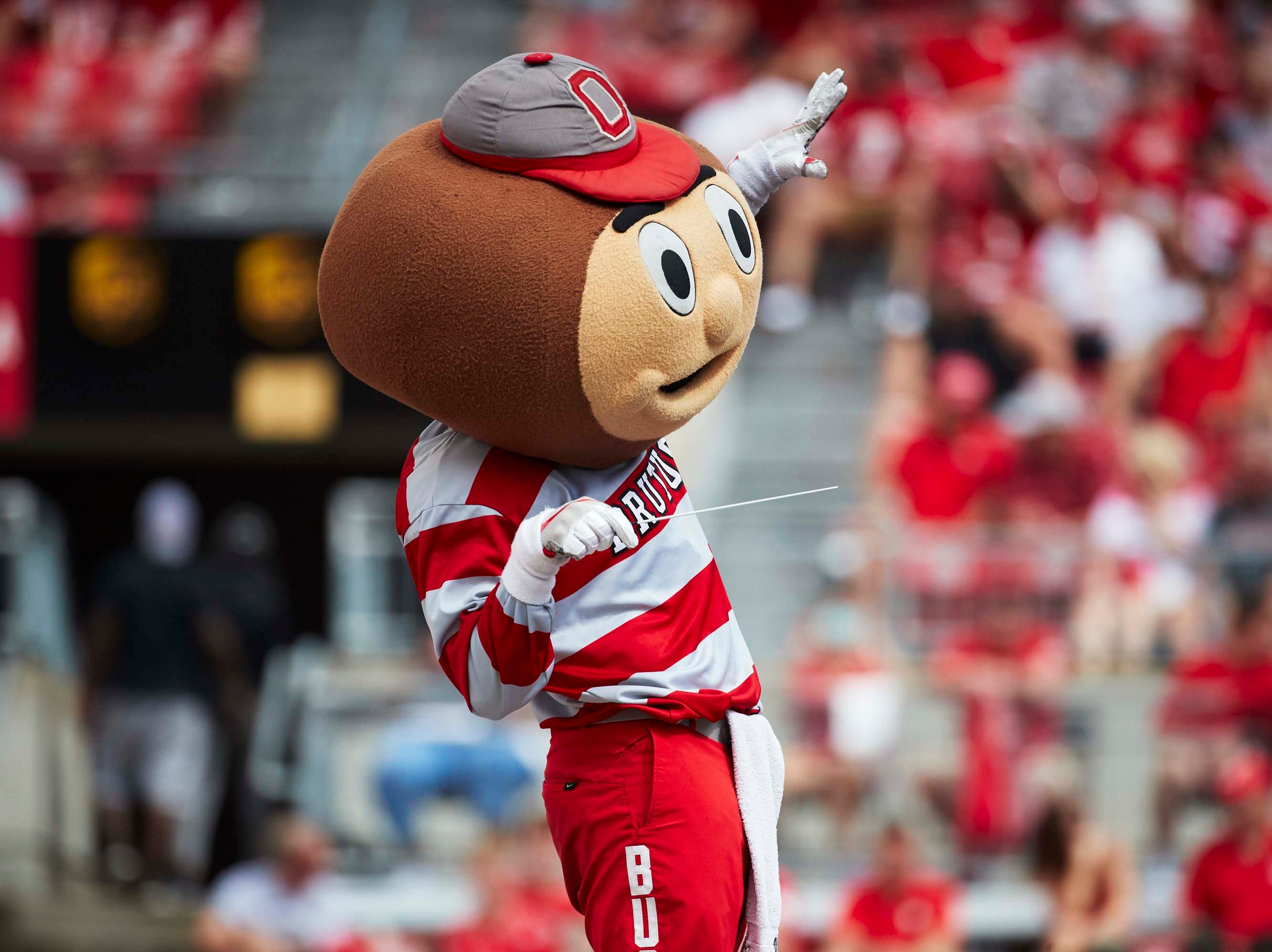 Week 1: Brutus Buckeye conducts the Ohio State marching band during the second half against the Oregon State Beavers at Ohio Stadium.