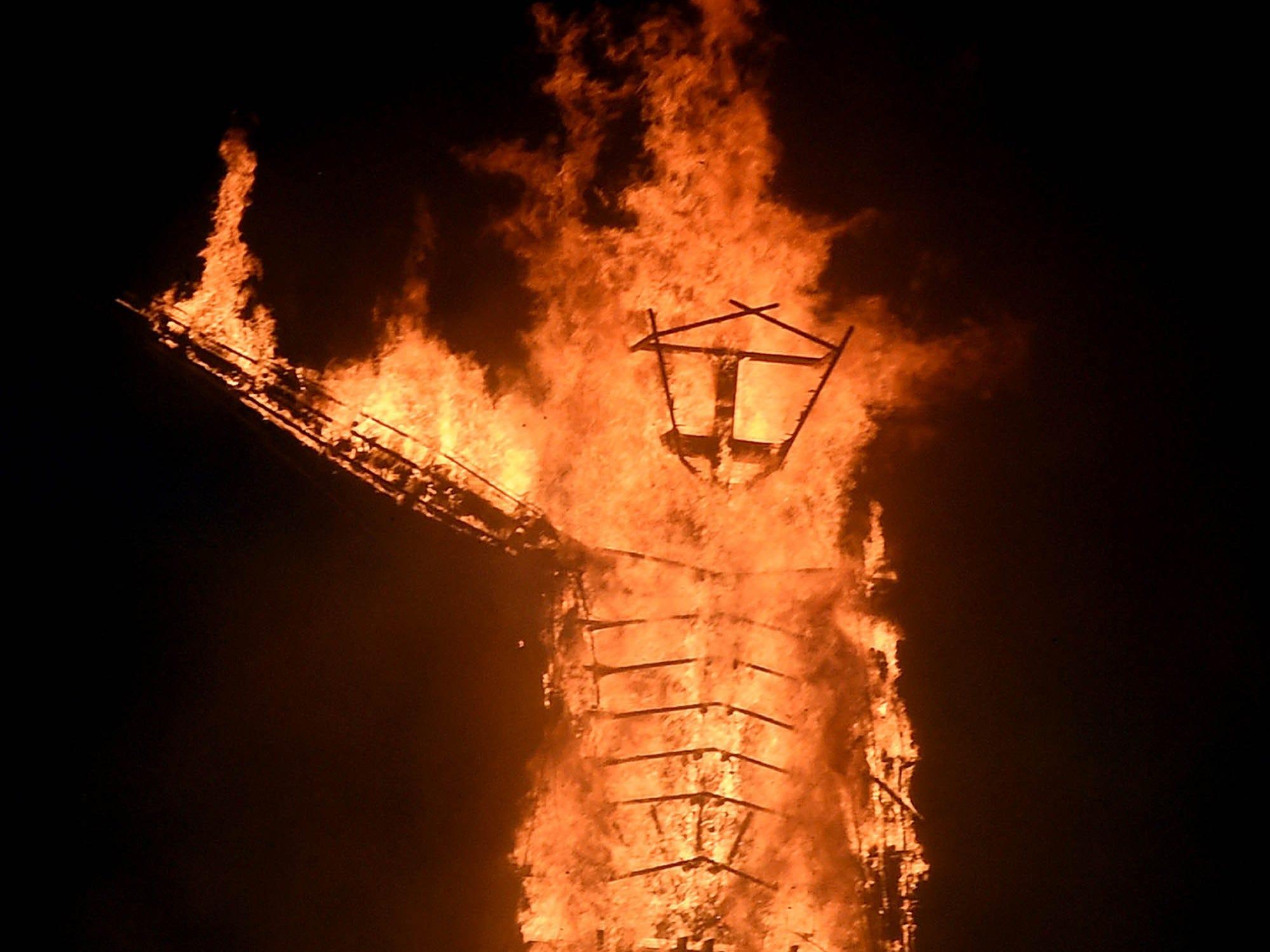 The Man effigy burns at Burning Man.