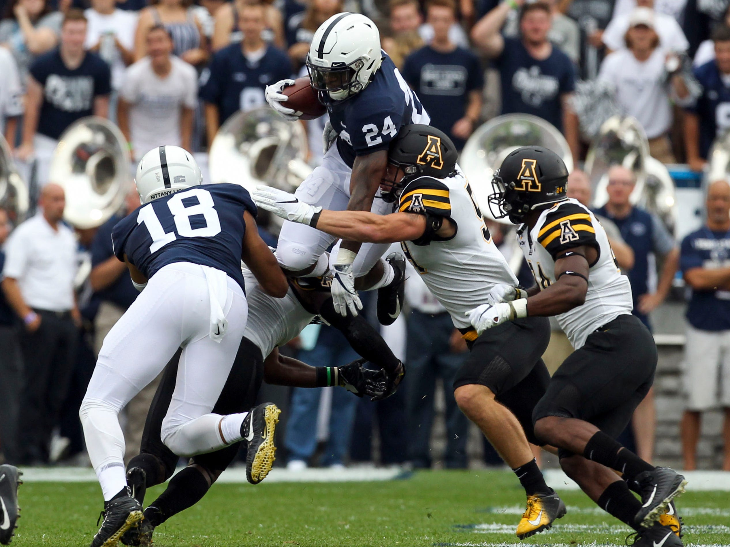Penn State running back Miles Sanders  jumps over a defender during the first quarter against Appalachian State.
