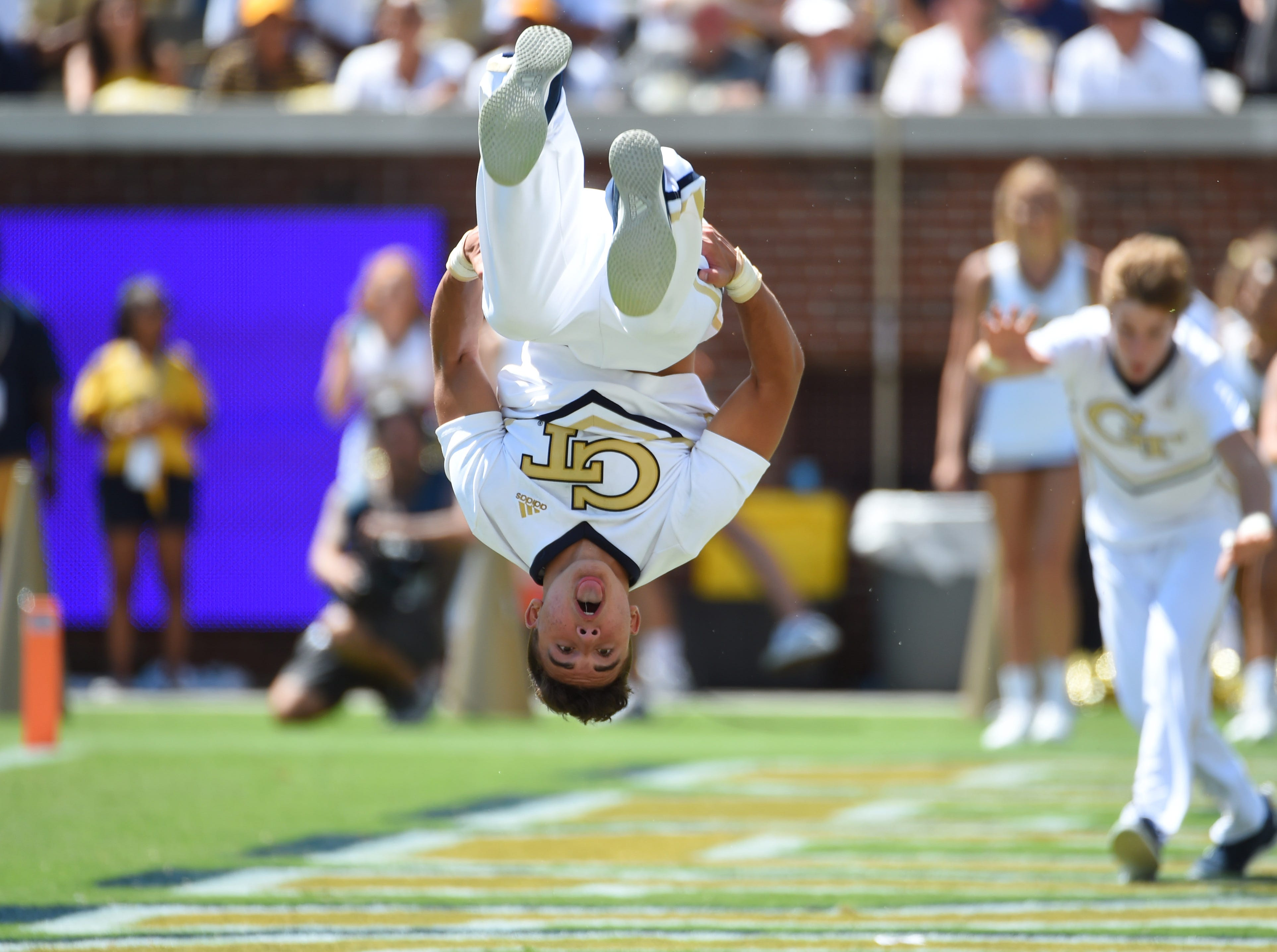 Week 1: A Georgia Tech Yellow Jackets cheerleader does a flip during the second half against the Alcorn State Braves at Bobby Dodd Stadium.