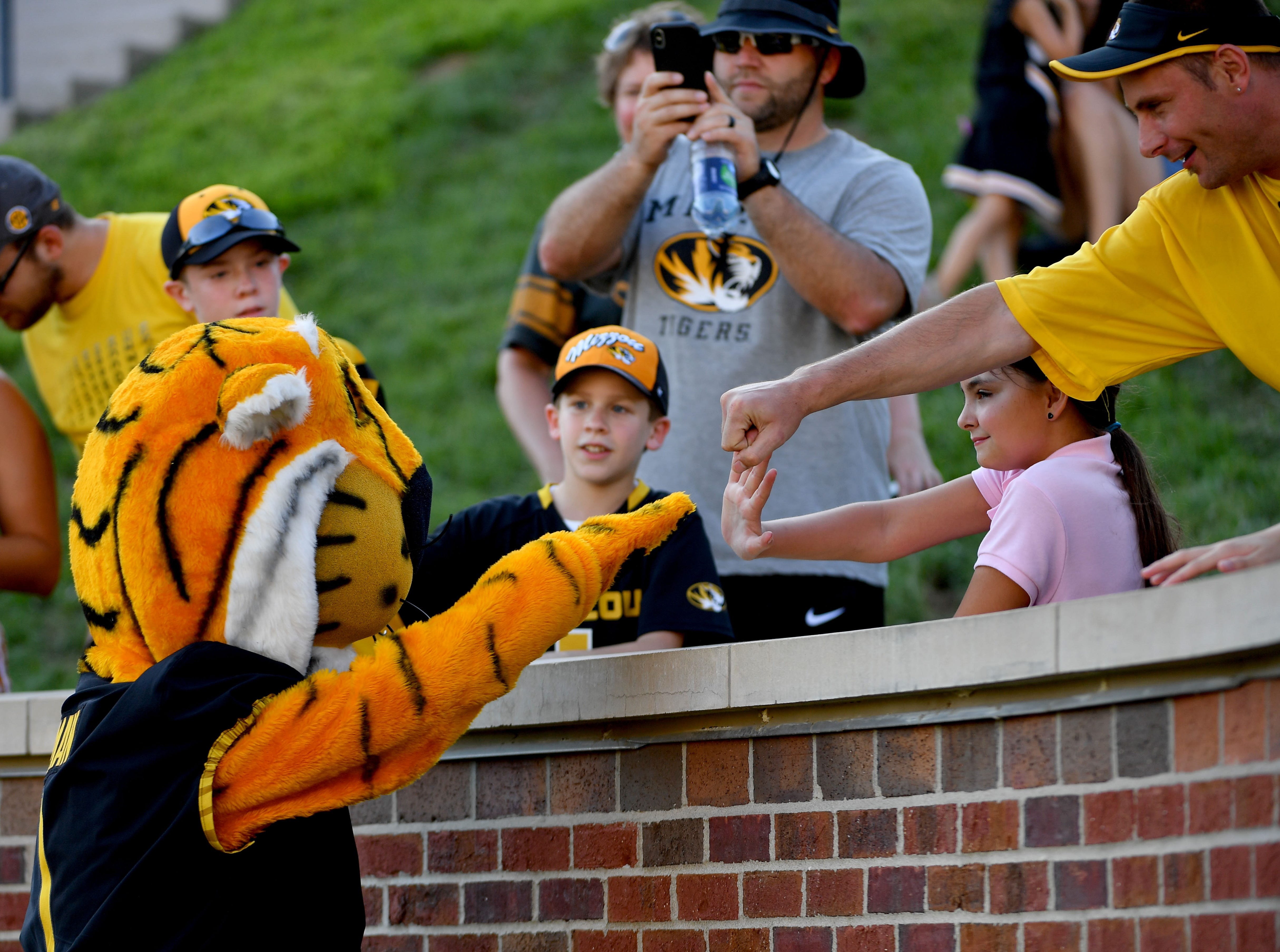 Week 1: Missouri Tigers mascot Truman fist-bumps fans during the second half against the Tennessee Martin Skyhawks.