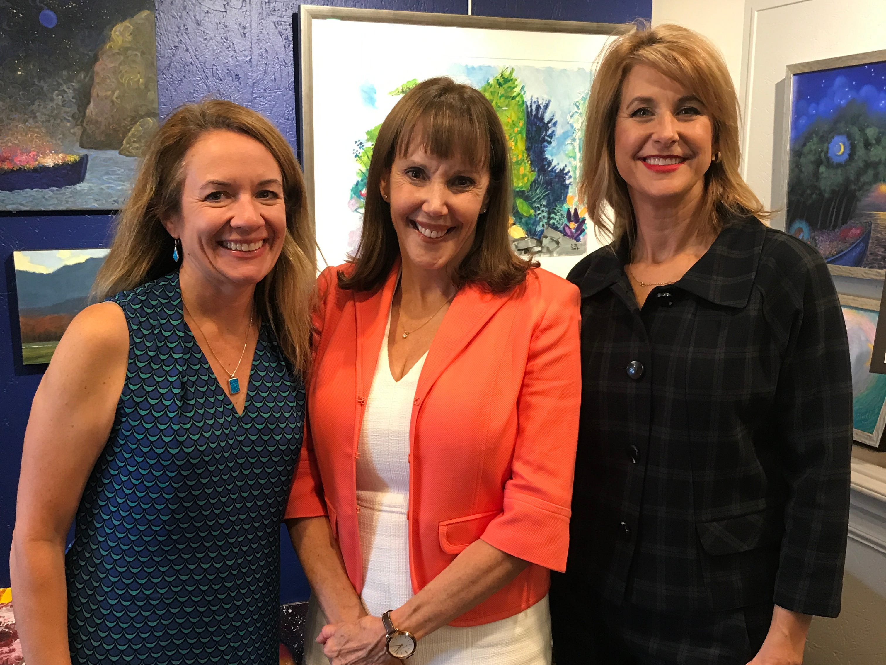 Some former McLean Little League softball moms are keeping the connection going long after their daughters aged out. From left, Justine Fitzgerald, Jayne O'Donnell and Heather Covington