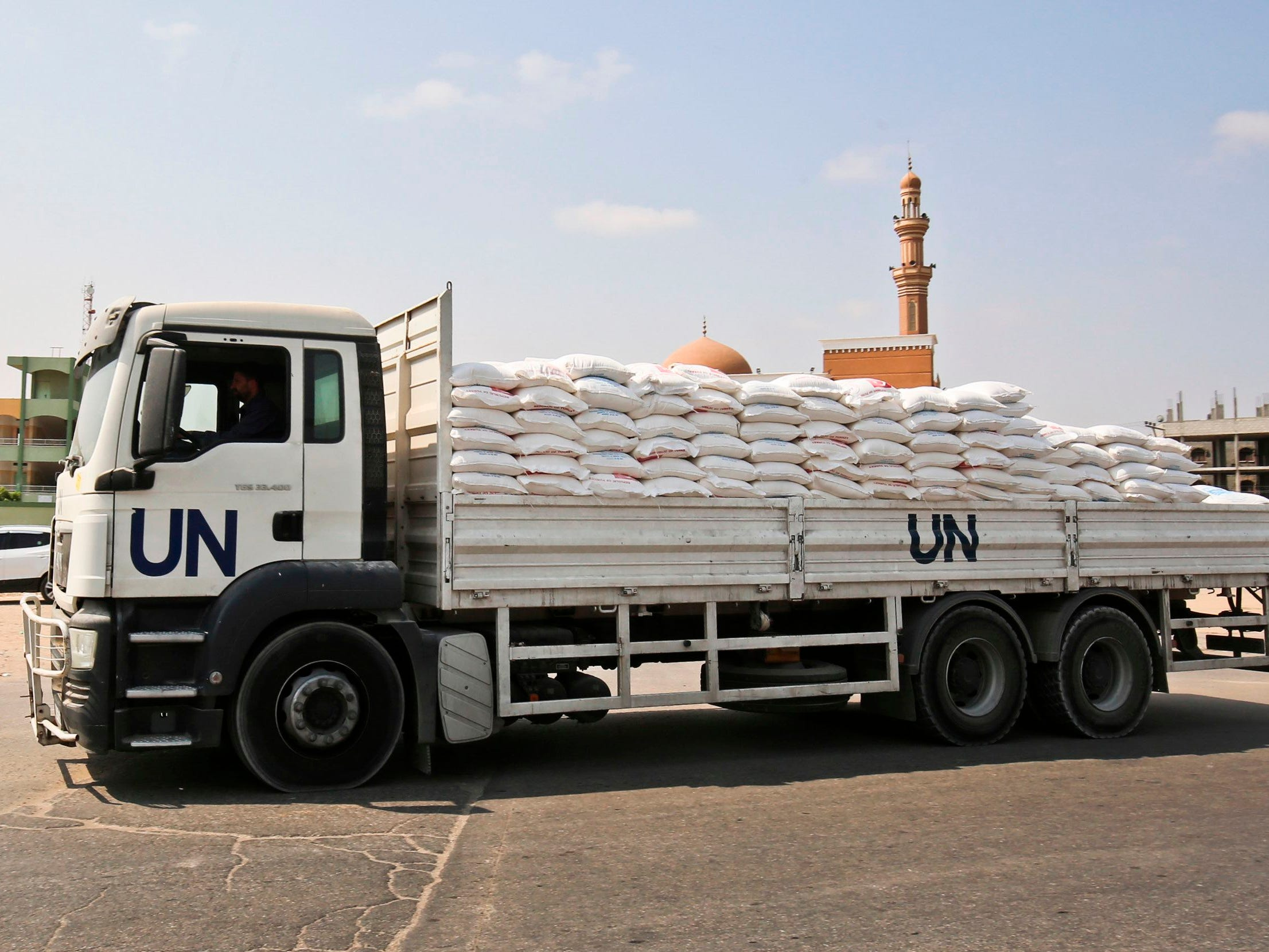 "A UN truck transports sacks of flour outside a United Nations' compound at the Rafah refugee camp in the southern Gaza Strip on September 1, 2018. - The United States announced it was halting funding for the United Nations' agency for Palestinian refugees after declaring the organisation was ""irredeemably flawed. Washington has long been the UN Relief and Works Agency's (UNRWA) largest donor but is ""no longer willing to shoulder the very disproportionate share of the burden,"" State Department spokeswoman Heather Nauert said in a statement. (Photo by SAID KHATIB / AFP)SAID KHATIB/AFP/Getty Images ORG XMIT: 191 ORIG FILE ID: AFP_18R7D9"