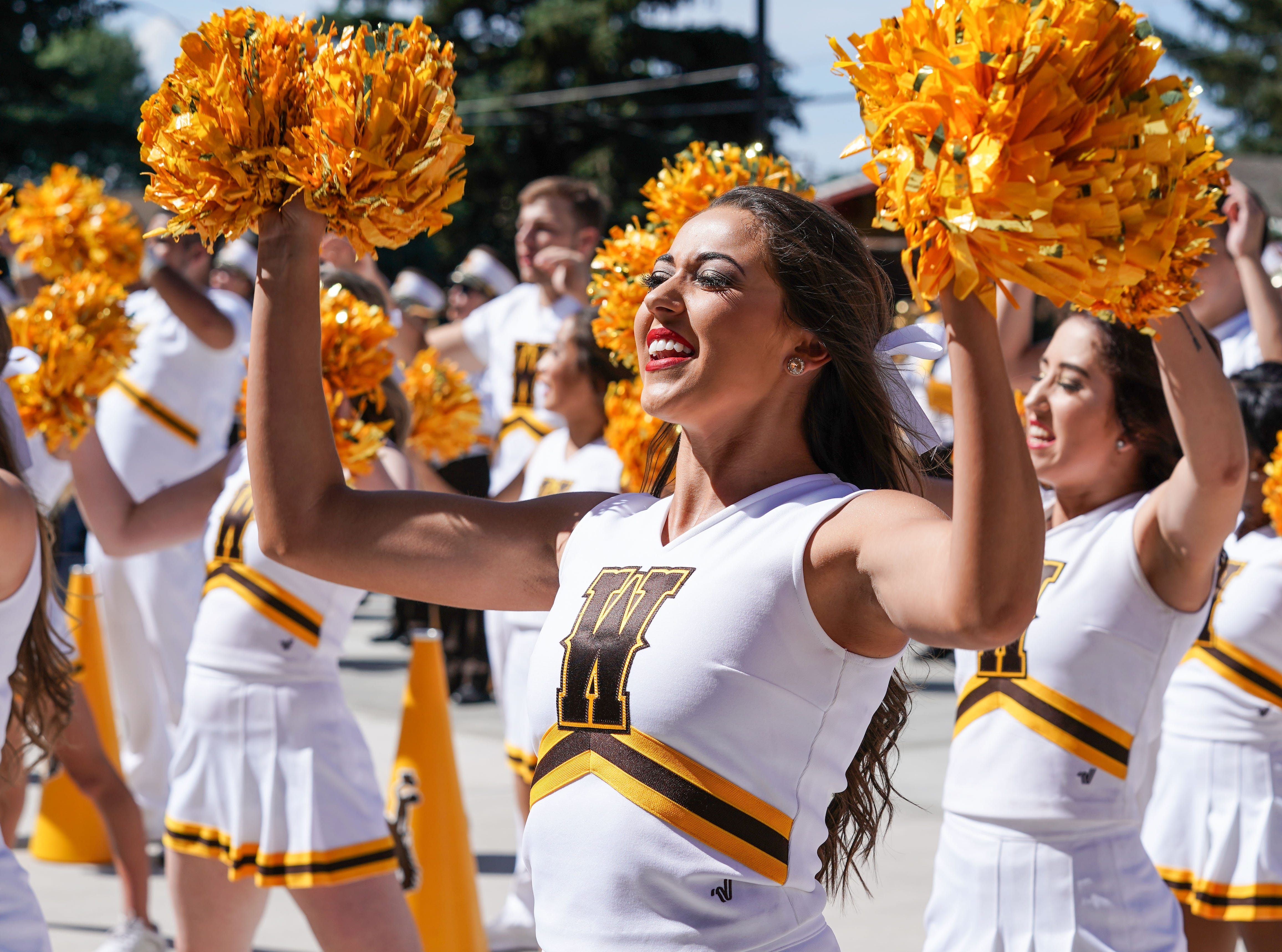 Week 1: Wyoming Cowboys cheerleaders perform before a game against the Washington State Cougars at War Memorial Stadium.