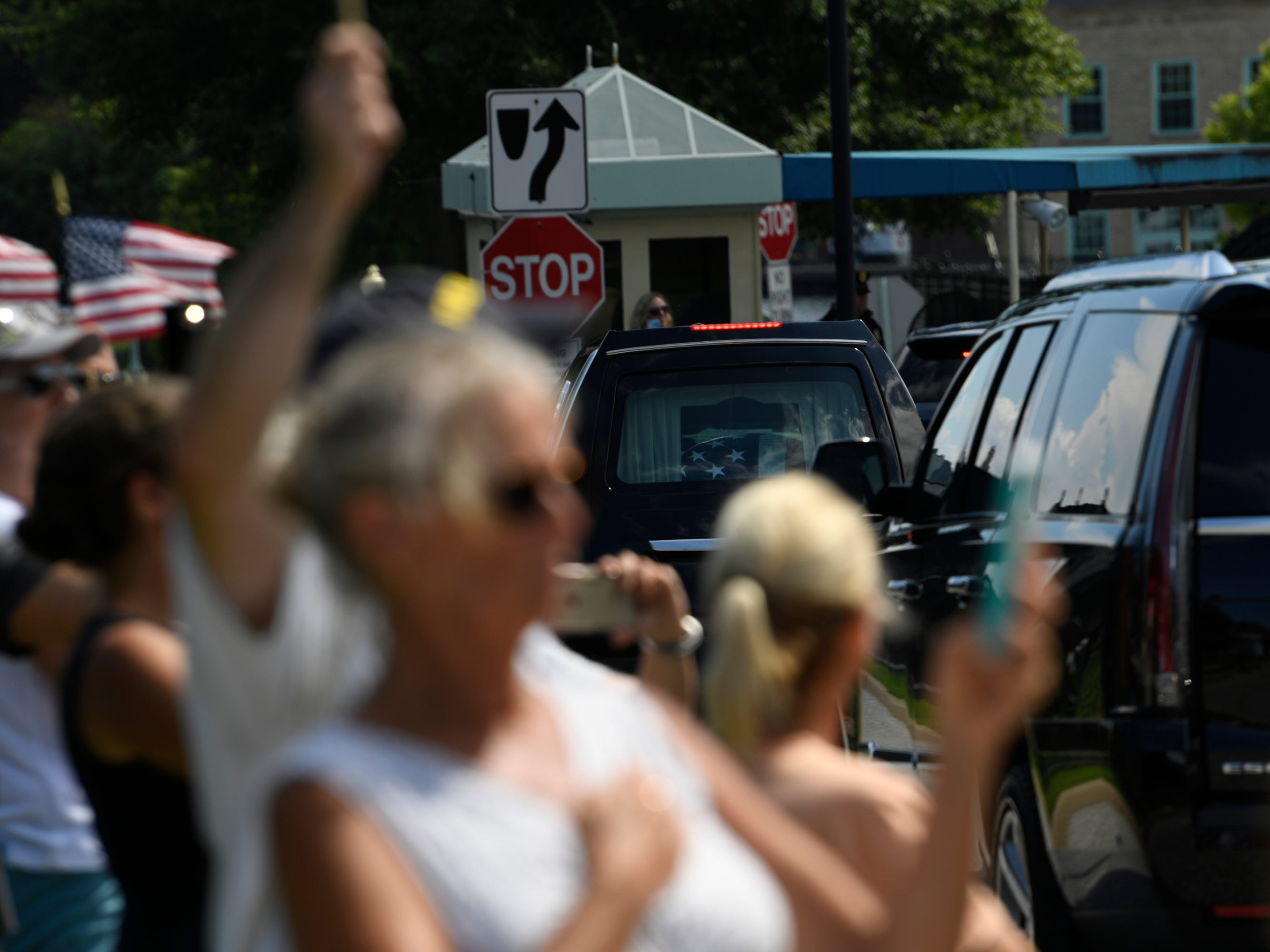 9/2/18 1:41:43 PM -- Annapolis, MD, U.S.A  -- People gather to watch the passing of John McCain's motorcade on his way to be laid to rest at the U.S. Naval Academy.  --    Photo by Jasper Colt, USA TODAY Staff ORG XMIT:  JC 137444 McCain Annapolis 9/2/2018 (Via OlyDrop)