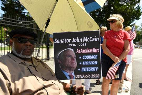 9/2/18 1:16:48 PM -- Annapolis, MD, U.S.A -- Charles James Sr. sits with a sign he made to watch the passing of John McCain's motorcade on his way to be laid to rest at the U.S. Naval Academy. -- Photo by Jasper Colt, USA TODAY Staff ORG XMIT: JC 137444 McCain Annapolis 9/2/2018 (Via OlyDrop)