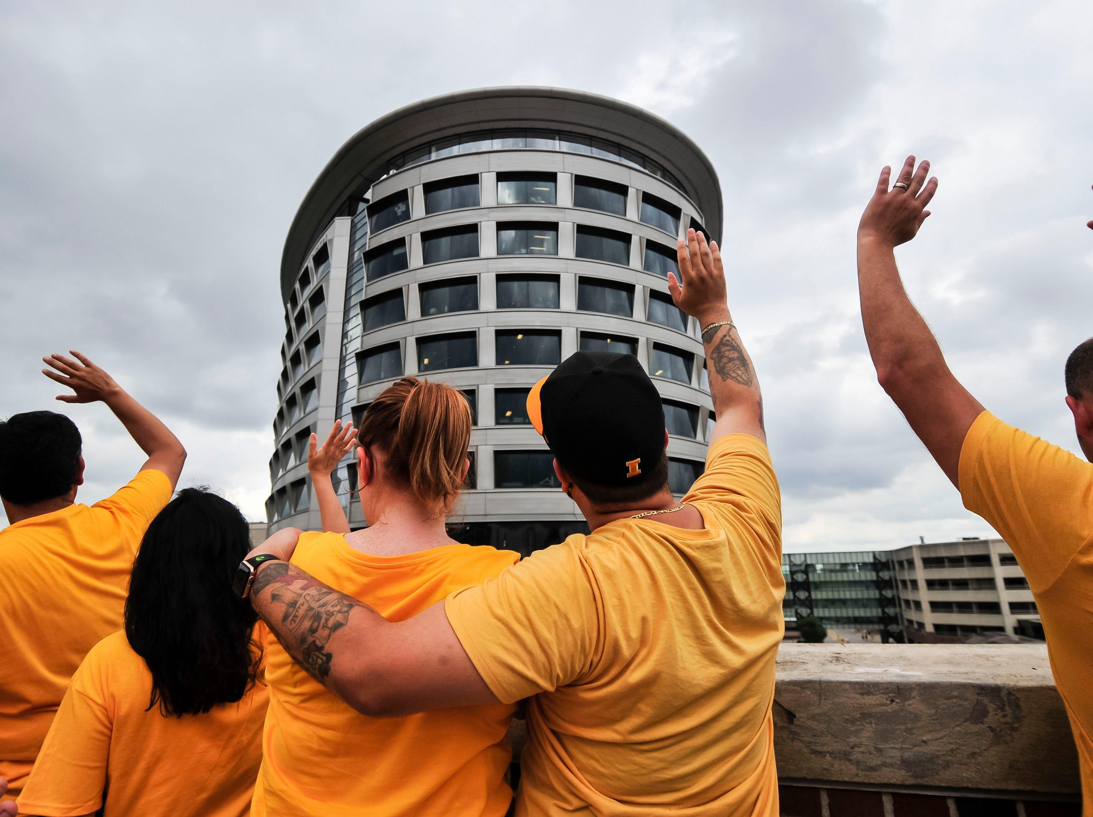 "Week 1: Iowa fans perform the ""Iowa Wave"" toward the university's Children's Hospital."