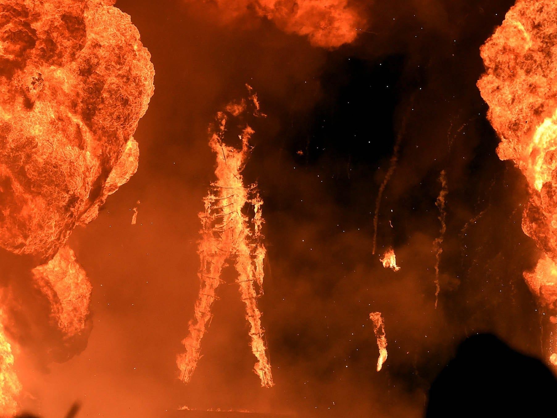 The Burning Man effigy burns.