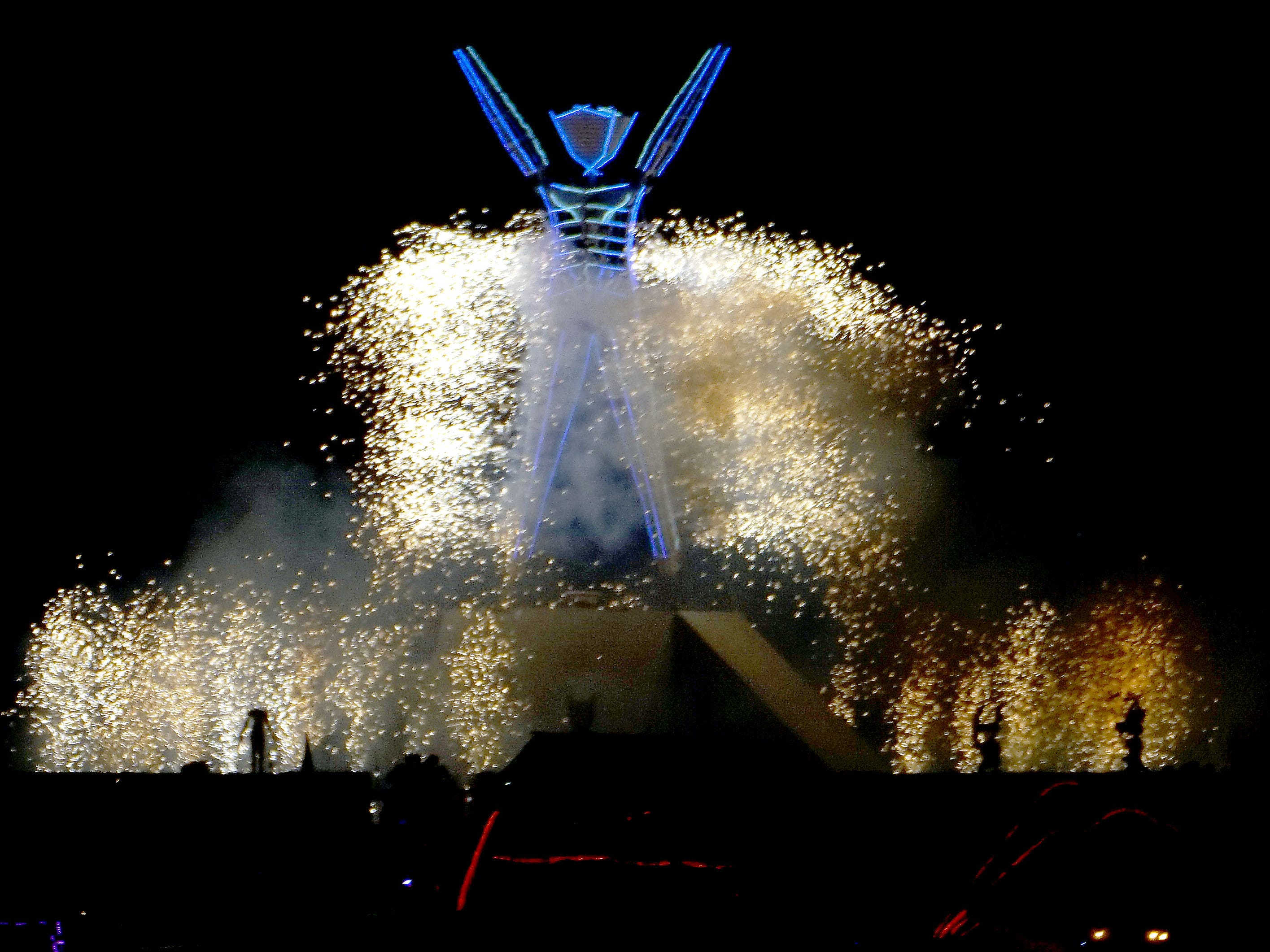 The approximately 100-foot-tall Man burns on Saturday night during a raucous celebration at Burning Man Sept. 2, 2018; Reno