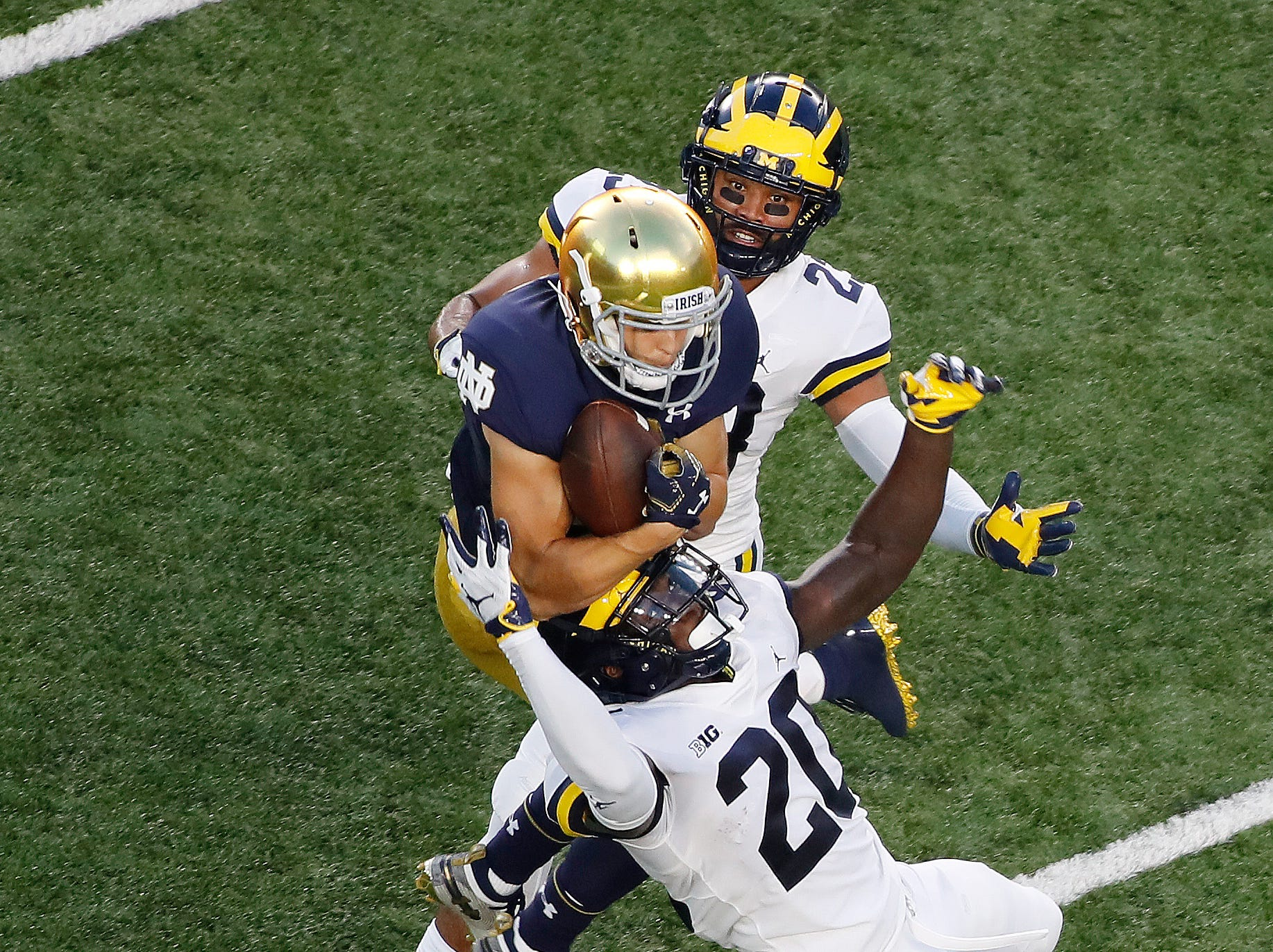 Notre Dame Fighting Irish wide receiver Chris Finke (10) catches a touchdown against the Michigan Wolverines.