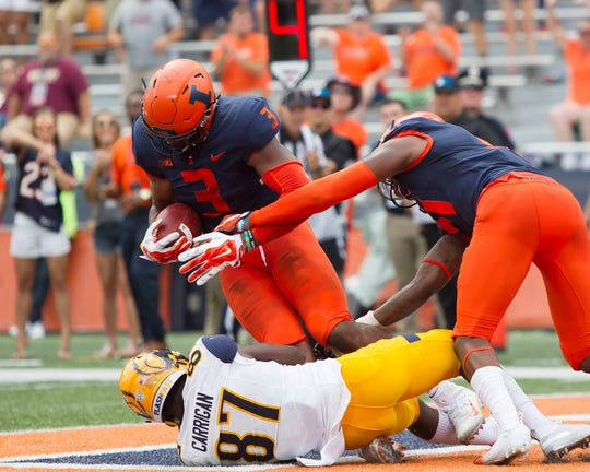 Illinois linebacker Del'Shawn Phillips intercepts a Kent State pass in the fourth quarter of their 31-24 win.