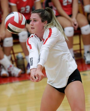 Neenah's Kayla Kraus digs the ball against Hortonville during a Fox Valley Association match Thursday in Hortonville.