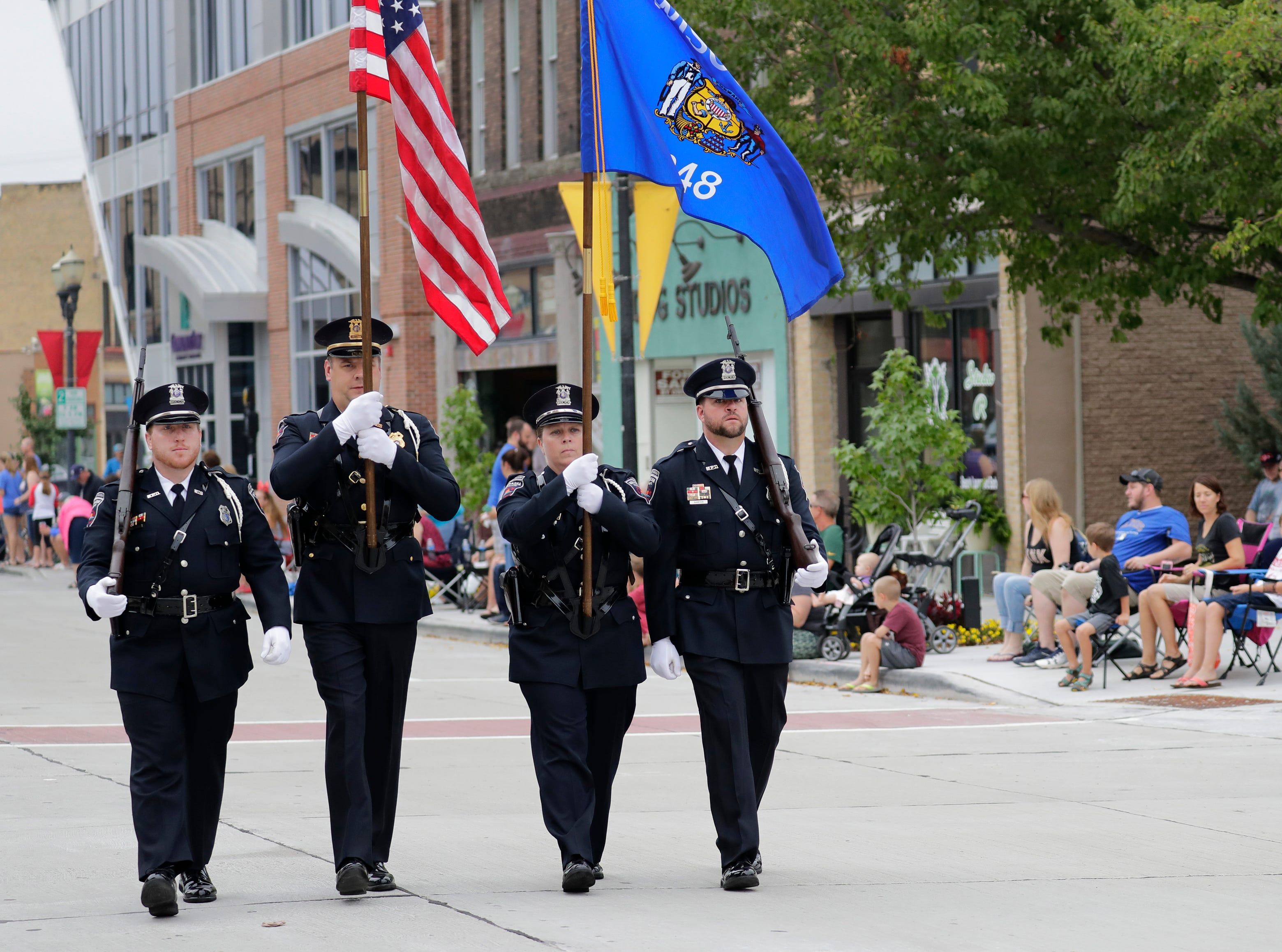 The Menasha Police Department's color guard march during the Neenah-Menasha Labor Day Parade Monday, Sept. 3, 2018, in downtown Menasha, Wis. 