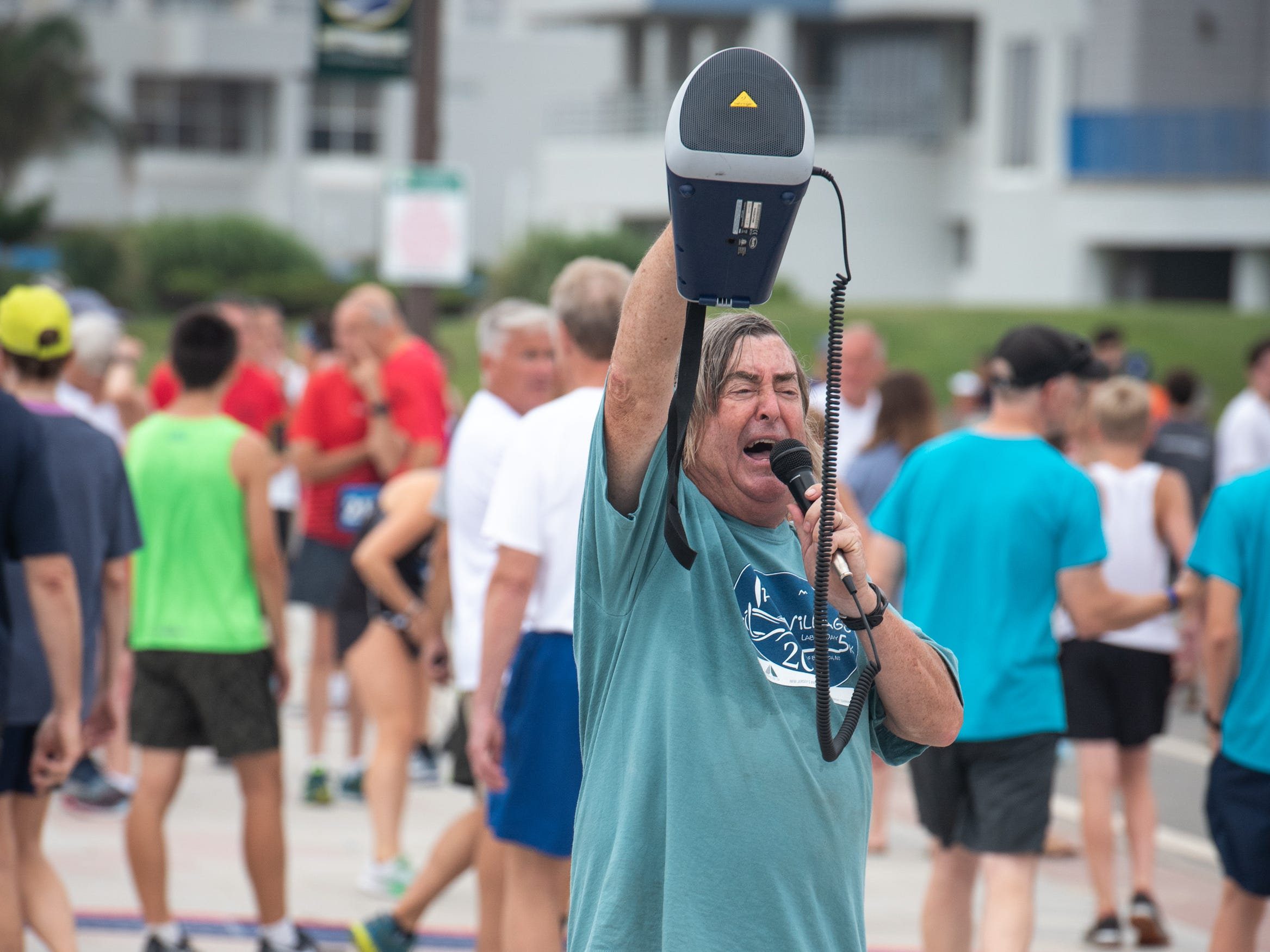 Race Director for the Pier House 5K run, Philip Hinck calls the runners to the starting line. The race was held along the ocean in the north end of Long Branch on Monday, September 3, 2018.  / Russ DeSantis for the Asbury Park Press