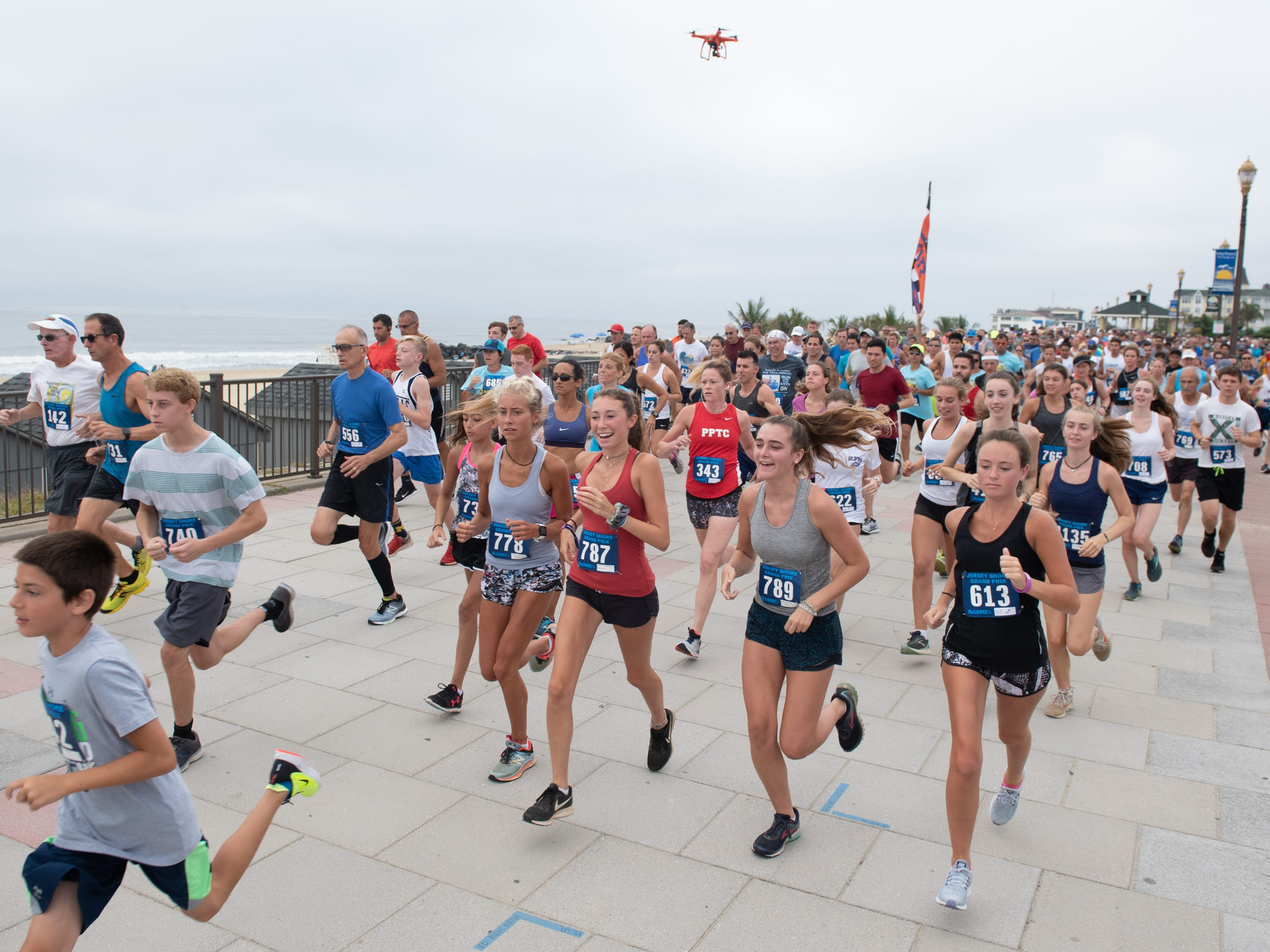 A drone follows the progress at the start of the race. The Pier House 5K run was held along the ocean in the north end of Long Branch on Monday, September 3, 2018.  / Russ DeSantis for the Asbury Park Press