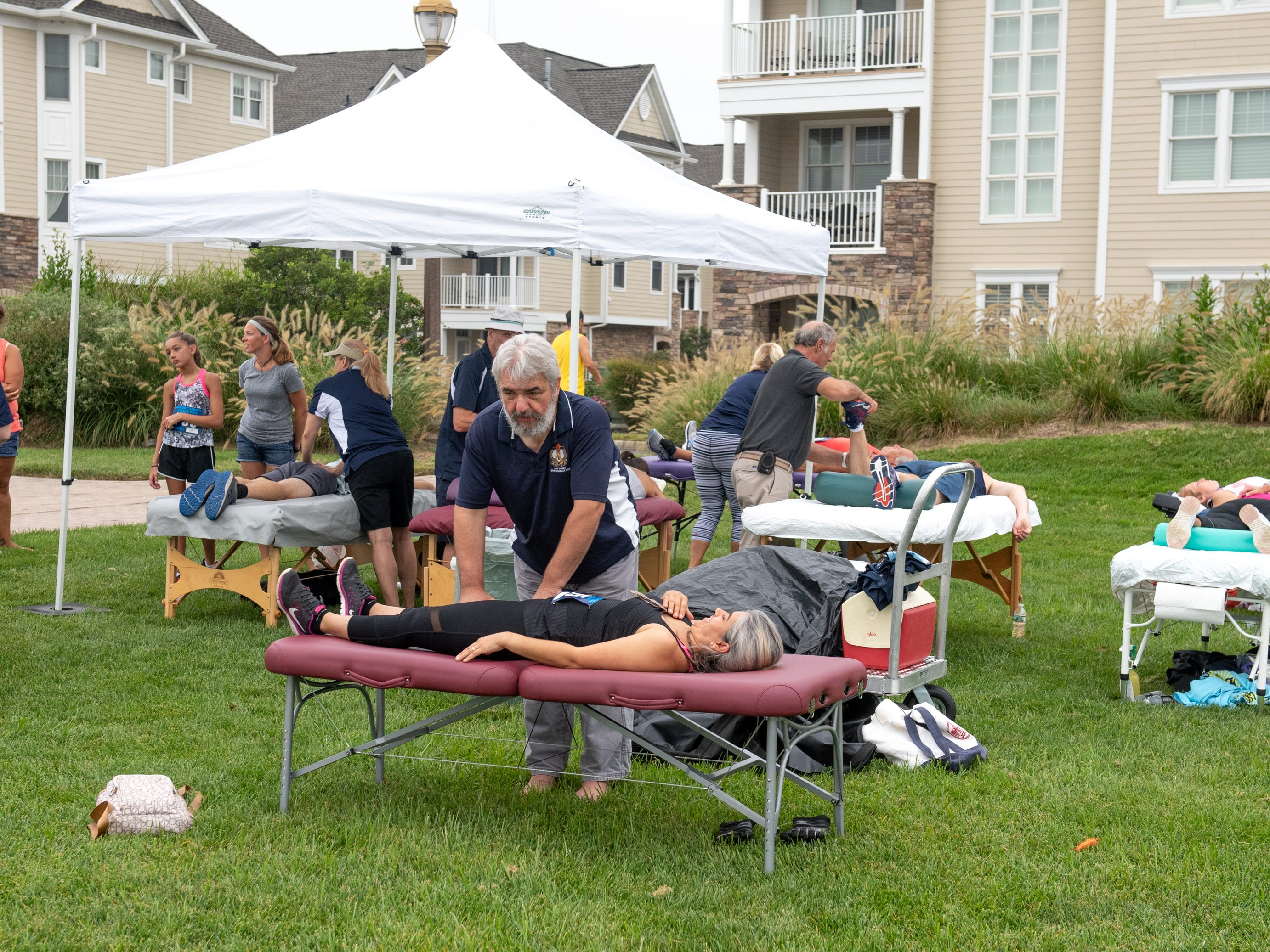 The Pier House 5K run was held along the ocean in the north end of Long Branch on Monday, September 3, 2018. Here, members of the American Massage Therapy Association, a national trade organization comprised of volunteer massage therapists, give massages prior to the race.  / Russ DeSantis for the Asbury Park Press