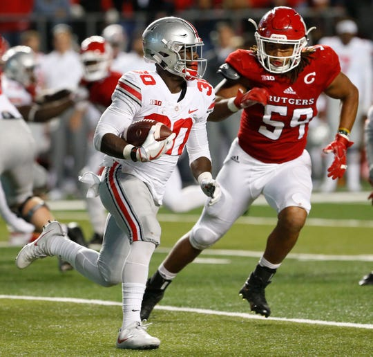 Ohio State Buckeyes running back DeMario McCall rushes against Rutgers Scarlet Knights defensive lineman Darnell Davis (59) during the second half at High Point Solutions Stadium.