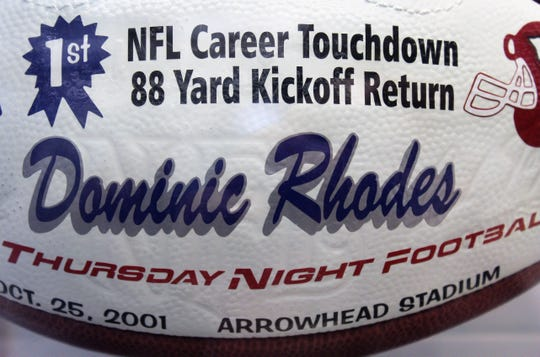 """Dominic Rhodes starred at Cooper High School and became a running back for the Indianapolis Colts. A football celebration one of his NFL firsts is part of the """"Hometown Teams"""" exhibit."""