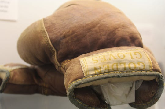 """Oldtimers will remember longtime Little League district administrator Jack Turner but may have forgotten he was a great boxer. Turner lost only five bouts, all in the Texas finals, before coaching local boxers from 1948-59. One of his gloves is on display in the """"Hometown Teams"""" exhibit at the downtown Abilene Public Library."""