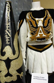 "A vintage Abilene High cheerleading outfit and megaphone are displayed at the Abilene Public Library. Local residents and organizations loaned cherished items to the ""Hometown Teams"" exhibit, here through Oct.  6."