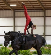Mary McCormick and Paris perform during a vaulting competition earlier this year at the Tryon International Equestrian Center.