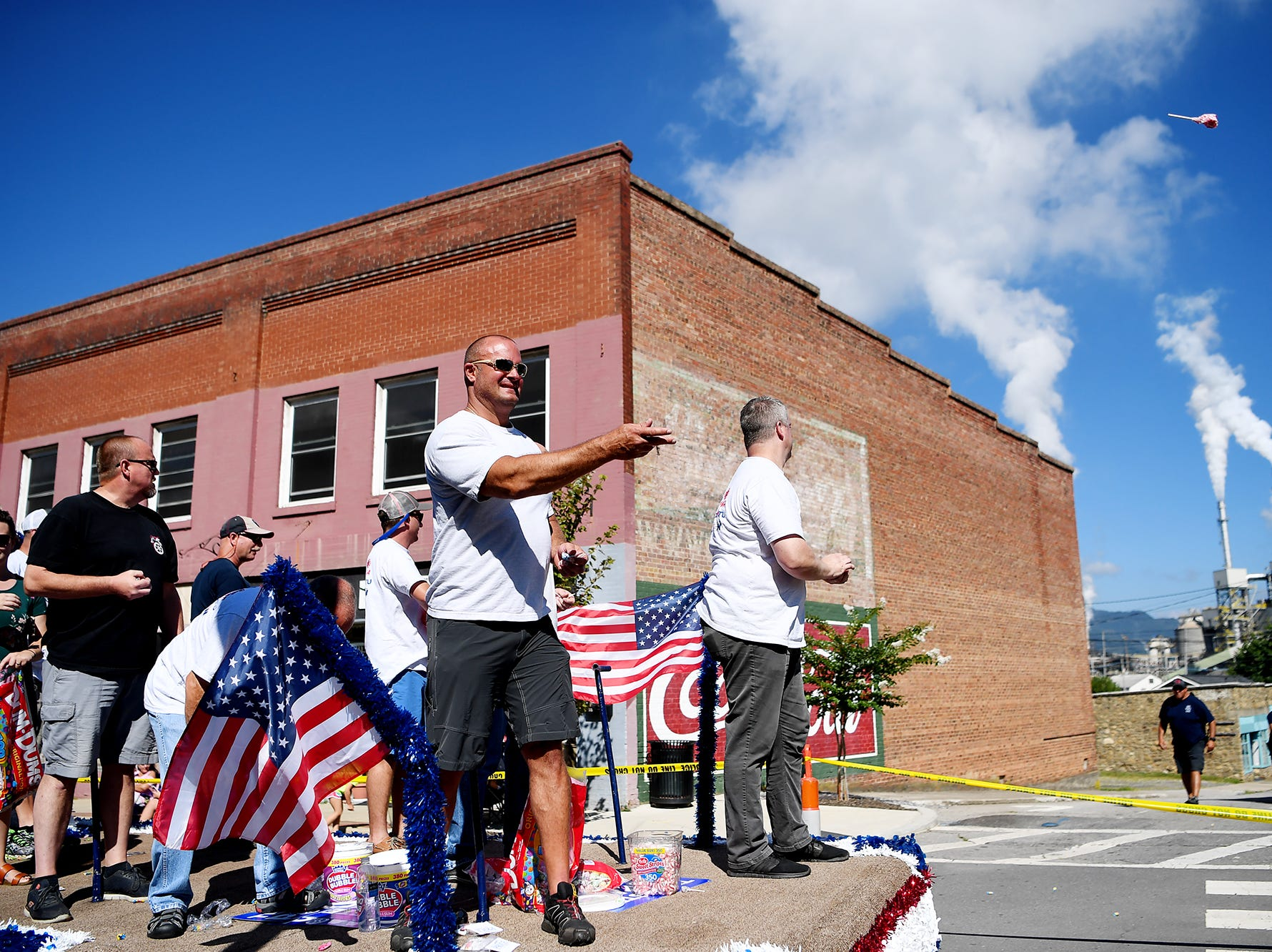 The Teamsters Local 61 float travels through downtown Canton during the Labor Day parade September 3, 2018.