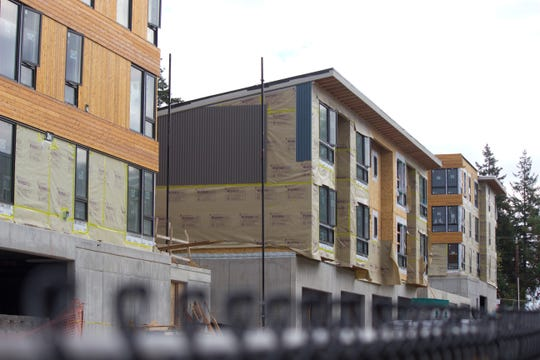 Units in Bainbridge Landing, a large housing development being built off the east end of Winslow Way, are expected to open in early 2019.