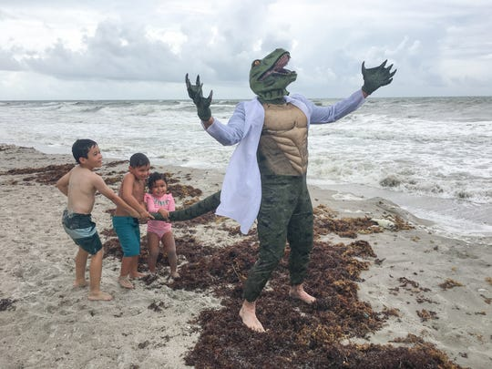On Labor Day 2018 at Pelican Beach, there were very few beachgoers. The ones who were there were from Make 'Em Laugh Films, who were filming a humorous video for their YouTube channel. The lizard is Bob Leatherow. Spider-Man hitting the surf is Matthew Scott Kimble.