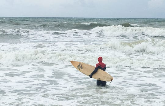 On Labor Day 2018 at Pelican Beach, there were very few beachgoers. The ones who were there were from Make 'Em Laugh Films, who were filming a humorous video for their YouTube channel. Spider-Man hitting the surf is Matthew Scott Kimble.