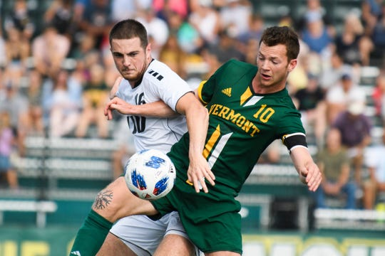 Vermont's Jon Arnar Barodal (10) and LUI's Huib Achterkamp (16) battle for the ball during the men's soccer game between the LIU Brooklyn Blackbirds and the Vermont Catamounts at Virtue Field on Sunday afternoon September 2, 2018 in Burlington.
